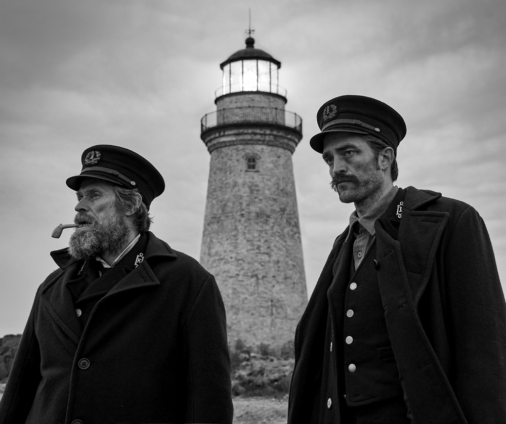 This image released by A24 shows Willem Dafoe, left, and Robert Pattinson in a scene from