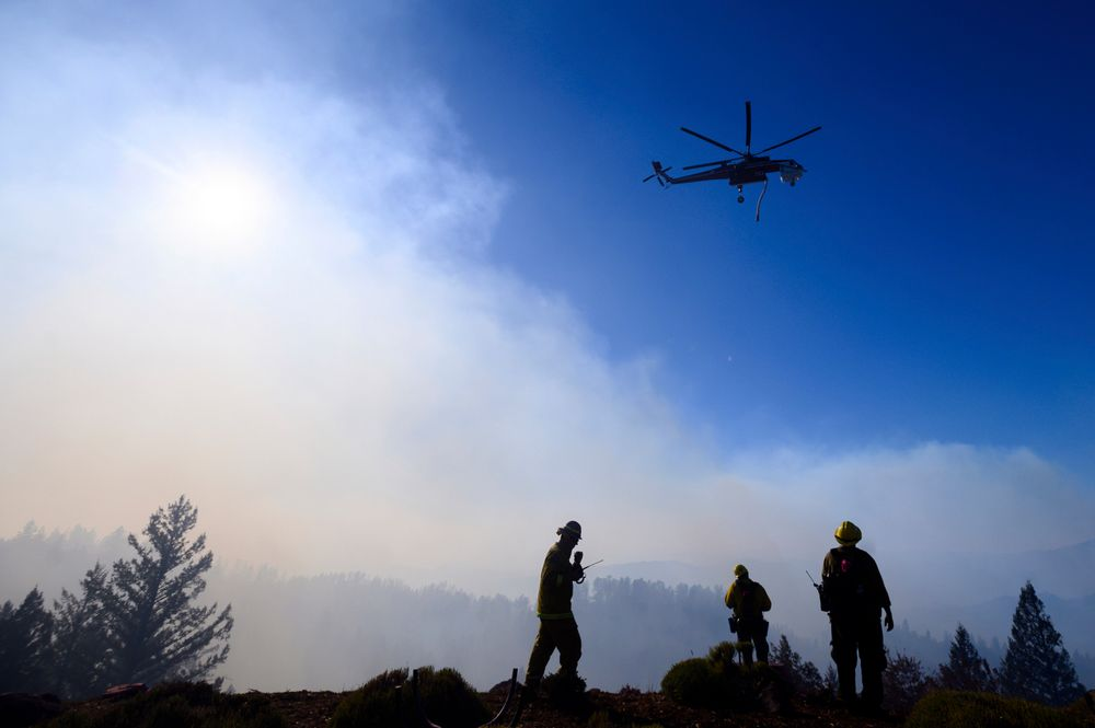 Firefighters monitor the Kincade Fire burning near Healdsburg, Calif., on Tuesday, Oct. 29, 2019. The overall weather picture in northern areas is improving, as powerful, dry winds bring extreme fire weather to Southern California. (AP Photo/Noah Berger)
