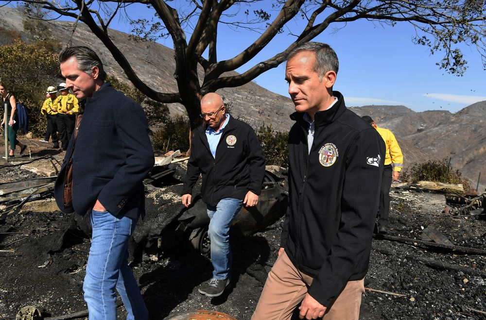 From left, California Governor Gavin Newsome, L.A. City Councilman Mike Bonin, and L.A. City Mayor Eric Garcetti tour a burned home along Tigertail Road in Brentwood, Calif., Tuesday Oct. 29, 2019. (Wally Skalij/Los Angeles Times via AP, Pool)
