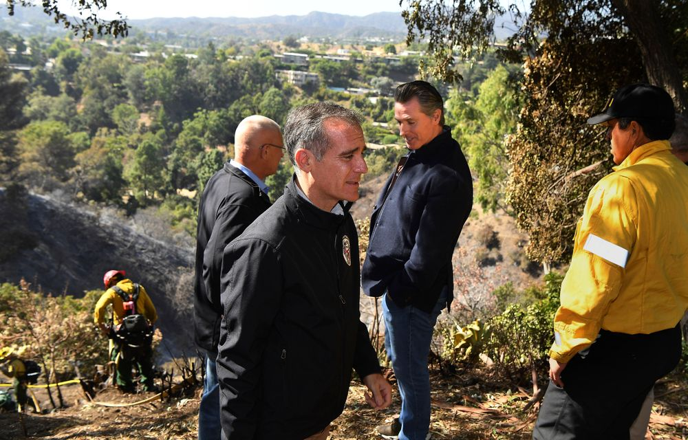 From left, L.A. City Councilman Mike Bonin, California L.A. City Mayor Eric Garcetti and California Governor Gavin Newsom tour Tigertail Road in Brentwood, Calif., Tuesday Oct. 29, 2019. (Wally Skalij/Los Angeles Times via AP, Pool)