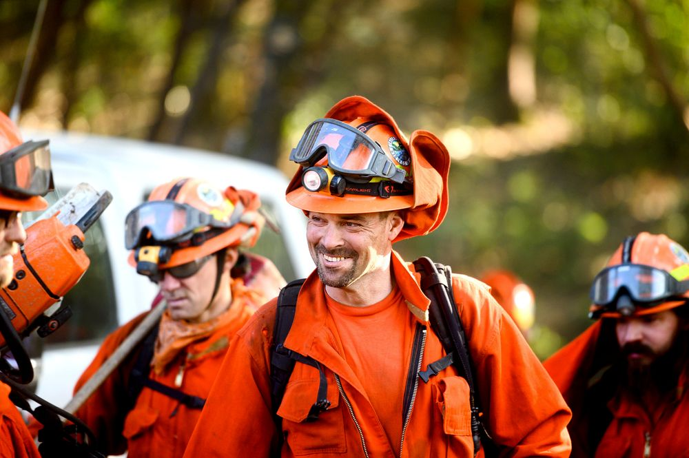Inmate firefighters prepare to battle the Kincade Fire near Healdsburg, Calif., on Tuesday, Oct. 29, 2019. The overall weather picture in northern areas is improving, as powerful, dry winds bring extreme fire weather to Southern California. (AP Photo/Noah Berger)