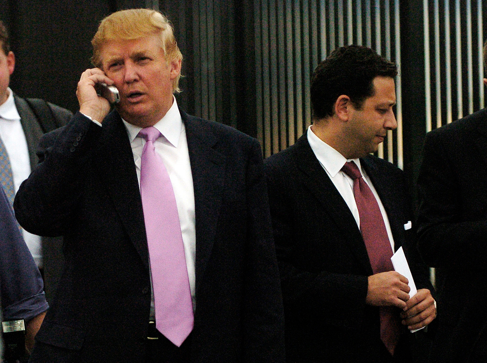 FILE - In this Sept. 14, 2005, file photo, businessman Donald Trump, left, talks on his cellphone with Felix Sater, right, outside after speaking at the Bixpo 2005 business convention at the Budweiser Events Center in Loveland, Colo. Sater, a Soviet emigre who befriended Trump over a series of development deals in the 2000s and pushed the Trump Tower Moscow project before and during the 2016 presidential campaign, has emerged as a key figure in House Democrats' investigations into Trump's Russia connections. (Cyrus McCrimmon/The Denver Post via AP)