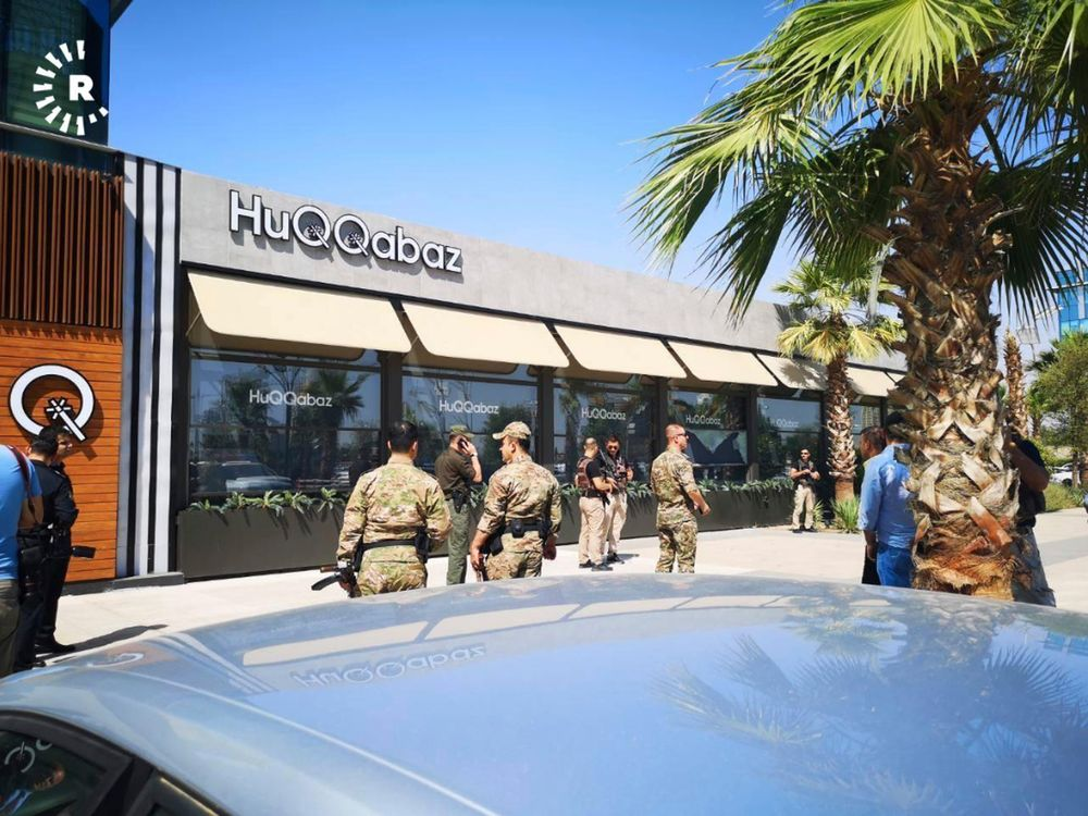 This image posted by RUDAW Facebook TV, an Irbil-based Kurdish broadcaster, shows security forces at the scene of a shooting outside a restaurant in Irbil, Iraq, Wednesday, July 17, 2019. Turkey's state-run news agency says a Turkish diplomat working at Ankara's consulate in the northern Iraqi city of Irbil was killed during a shooting attack inside the restaurant there. (RUDAW Facebook TV via AP)