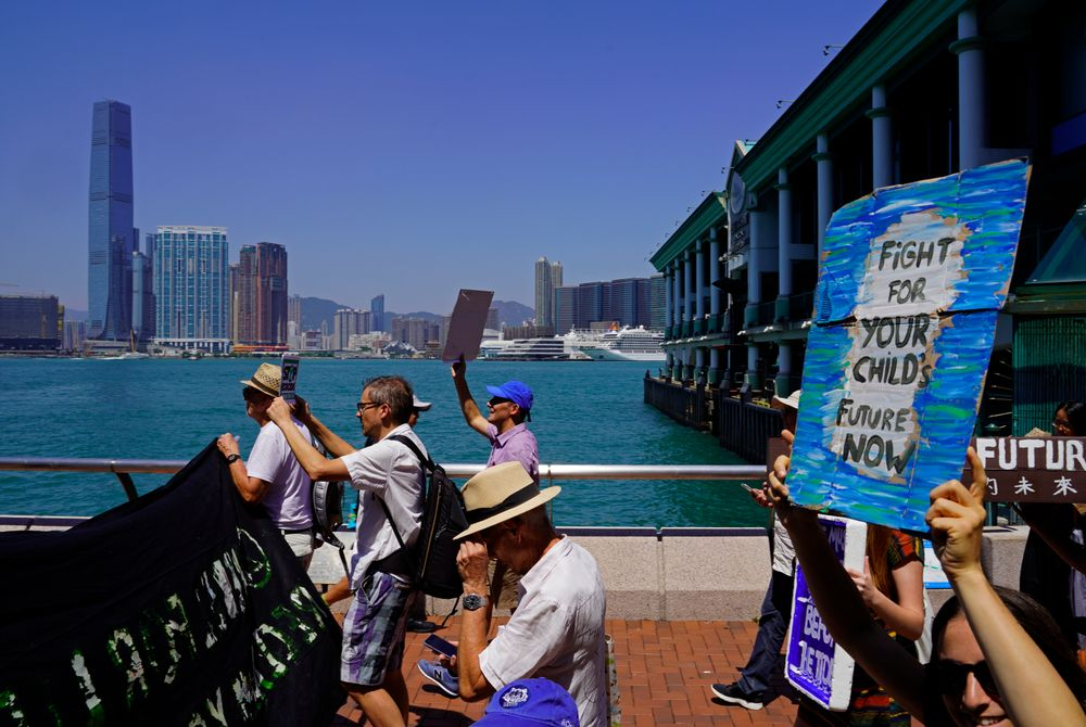 Protesters with placards participate in the Global Strike 4 Climate rally in Hong Kong, Friday, Sept. 20, 2019. Protesters are gathering as a day of worldwide demonstrations begins ahead of a U.N. climate summit in New York. (AP Photo/Vincent Yu)
