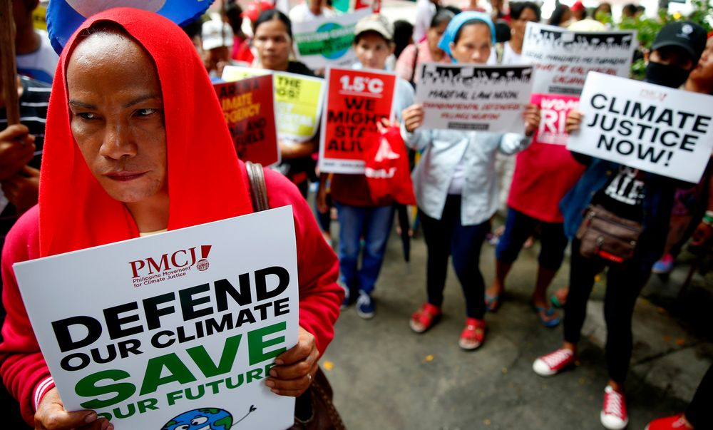 Environmental activists hold placards during a rally outside the Department of Environment and Natural Resources to coincide with the global protests on climate change Friday, Sept. 20, 2019 at suburban Quezon city, northeast of Manila, Philippines. Various environmental groups in the country are participating in what is expected to be the world's largest mobilization on climate change known as