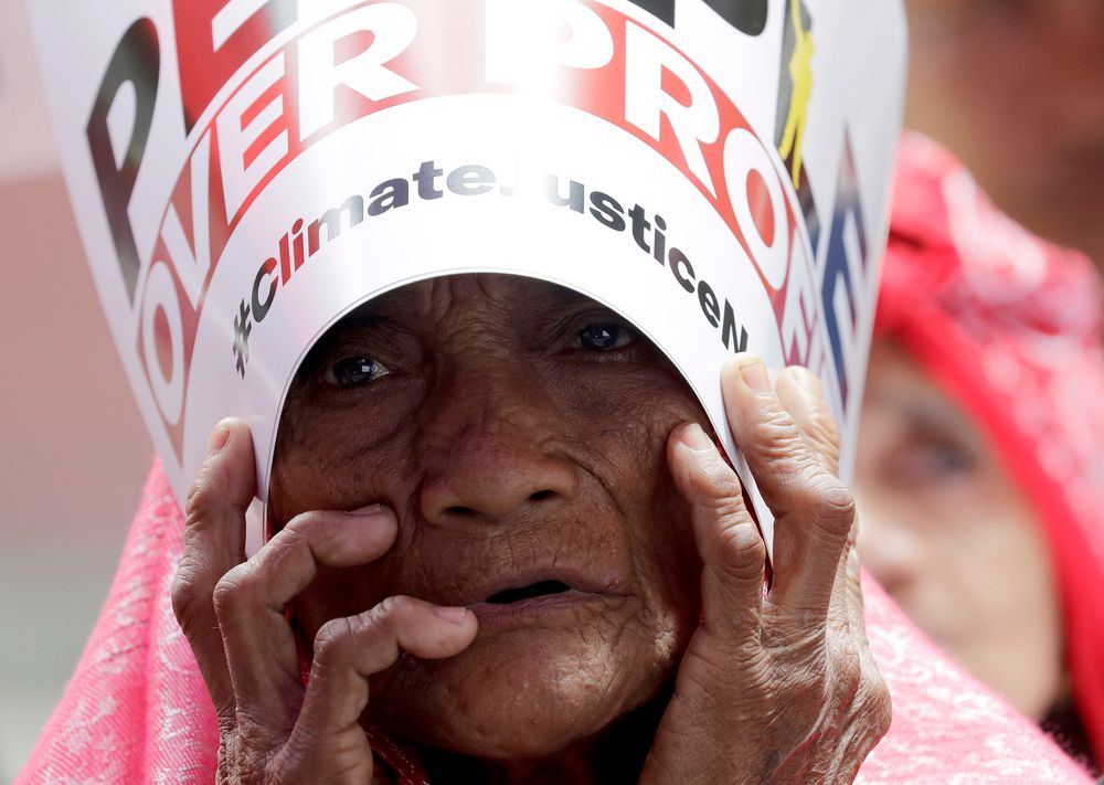 An environmental activist holds a placard during a rally outside the Department of Environment and Natural Resources to coincide with the global protests on climate change Friday, Sept. 20, 2019 at suburban Quezon city, northeast of Manila, Philippines. Various environmental groups in the country are participating in what is expected to be the world's largest mobilization on climate change known as
