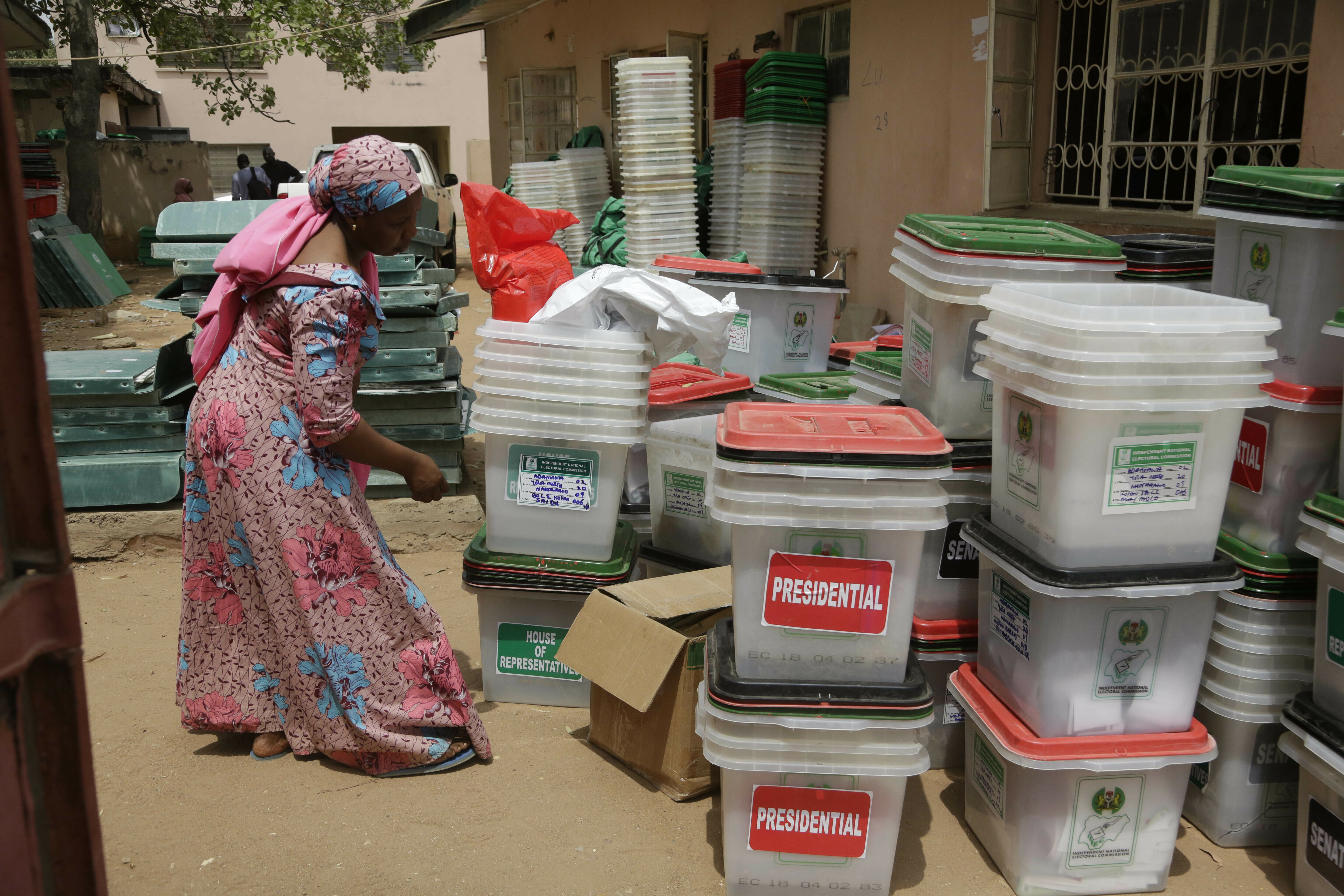 An electoral worker checks ballot boxes at the electoral commission office in Yola, Nigeria, Sunday, Feb. 24, 2019. Vote counting continued Sunday as Nigerians awaited the outcome of a presidential poll seen as a tight race between the president and a former vice president. (AP Photo/Sunday Alamba)