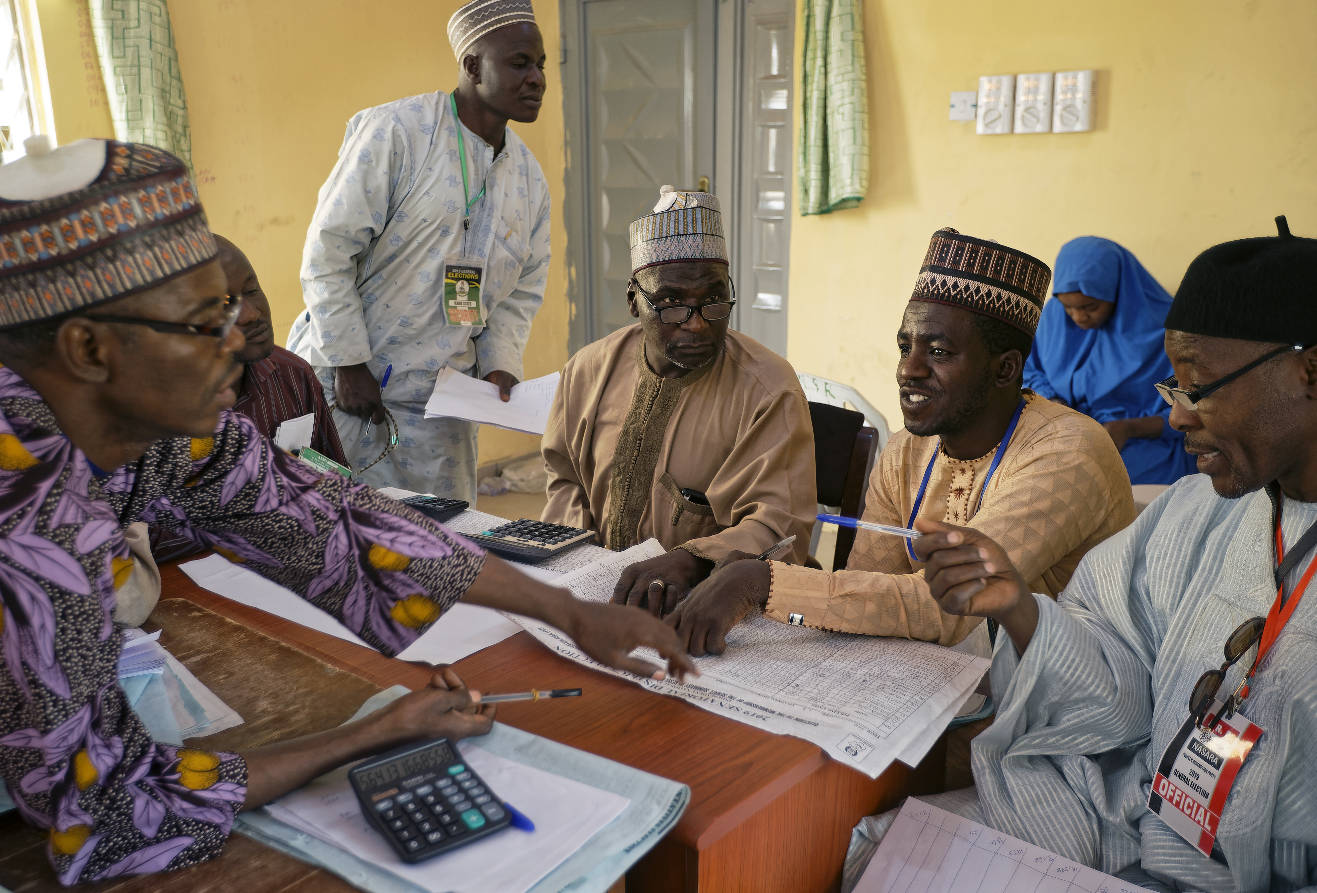 Electoral officials compile voting results at a collation center in Kano, northern Nigeria Sunday, Feb. 24, 2019. Vote counting continued Sunday as Nigerians awaited the outcome of a presidential poll seen as a tight race between the president and a former vice president. (AP Photo/Ben Curtis)