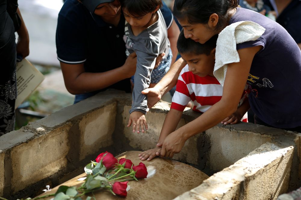 Family members pay their last respects to Maria del Carmen Segovia Padua as they prepare to bury her alongside her aunt Zuleyma Hernandez Sanchez at the municipal cemetery in Coatzacoalcos, Veracruz state, Mexico, Thursday, Aug. 29, 2019. Mexico's President Andres Lopez Obrador insists his go-slow policies of reducing youth unemployment will eventually solve the root causes of violent crime better than declaring another frontal offensive against drug cartels. (AP Photo/Rebecca Blackwell)