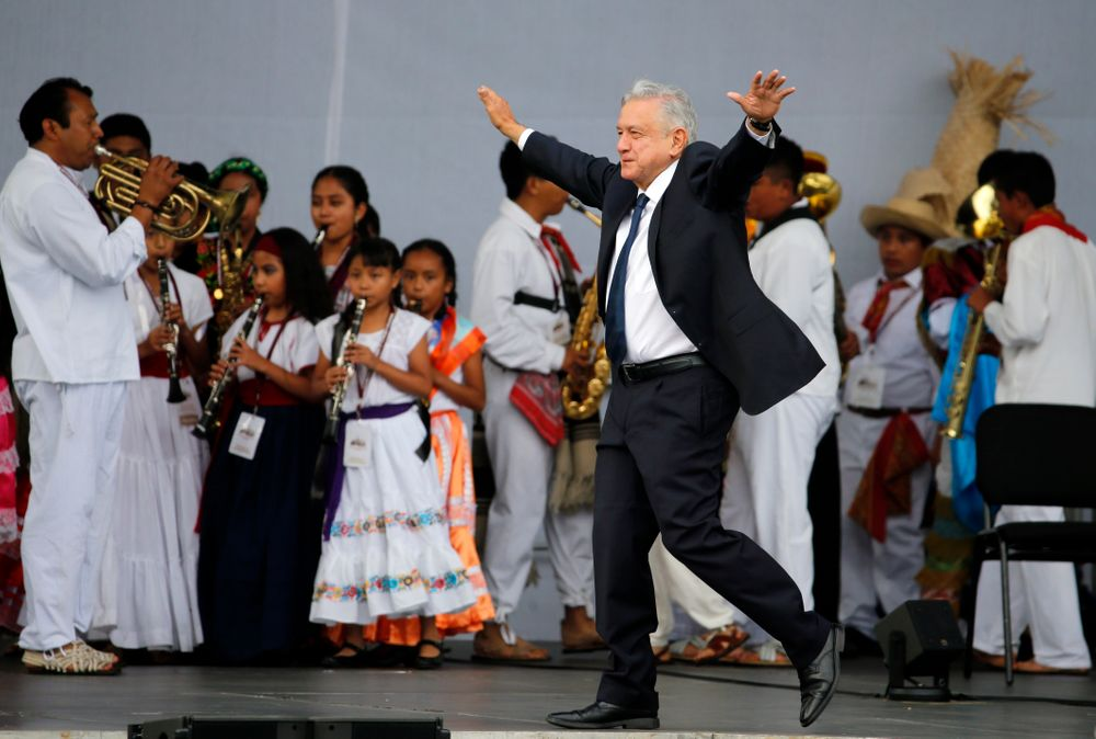FILE - In this July 1, 2019 file photo, Mexico's President Andres Manuel Lopez Obrador greets supporters as he arrives at a rally to celebrate the one-year anniversary of his election, in Mexico City's main square, the Zocalo. Lopez Obrador's high approval ratings topped 70% in some polls nine months into his term. Many Mexicans are willing to give Lopez Obrador the benefit of the doubt as even the president acknowledges that violent crime is the most serious challenge he faces. (AP Photo/Fernando Llano, File)