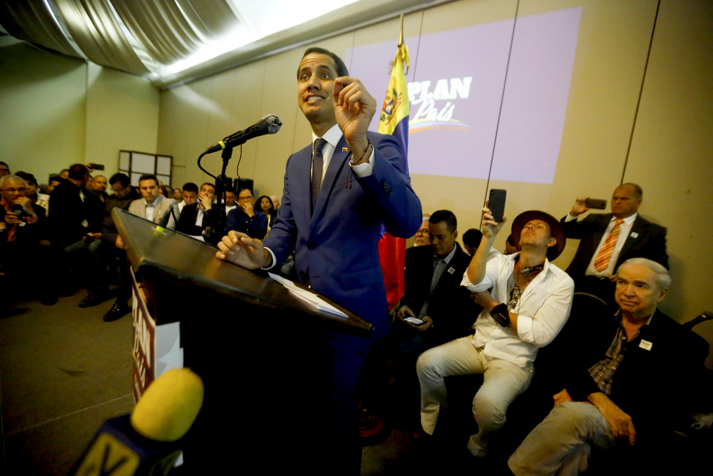 Venezuela's opposition leader and self-proclaimed interim president Juan Guaido delivers a speech during a meeting with supporters at a hotel in Valencia, Venezuela, June 7, 2019. A member of Venezuela's opposition said that a mediation effort by Norway is stalling over Nicolás Maduro's refusal to accept presidential elections to resolve the nation's political crisis. (AP Photo/Juan Carlos Hernandez)
