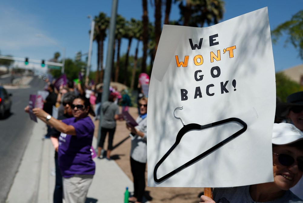 People rally in support of abortion rights Tuesday, May 21, 2019, in Las Vegas. Some Democratic-led states are taking steps to enshrine the right to an abortion should the U.S. Supreme Court ever overturn the 1973 Roe v Wade decision. Among them are Nevada, New York and Vermont. (AP Photo/John Locher)