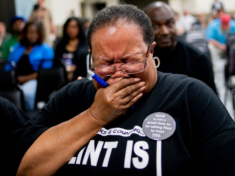 Marijoyce Campbell, a 65-year-old lifelong Flint resident, sheds tears as she gets choked up after speaking her mind during a community meeting with Flint water prosecutors at UAW Local 659, Friday, June 28, 2019, in Flint, Mich. Campbell said she had a