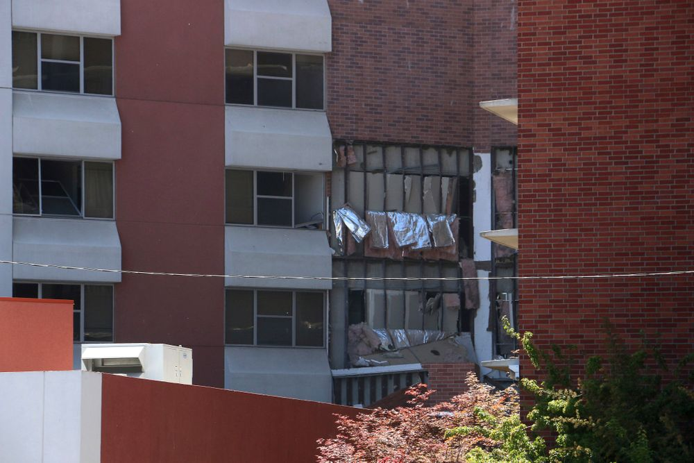 Damage is seen from an explosion at Argenta Hall on the University of Nevada, Reno, campus on Friday, July 5, 2019, in Reno, Nev. A Reno city spokesman says minor injuries have been reported after a utilities accident caused an explosion and