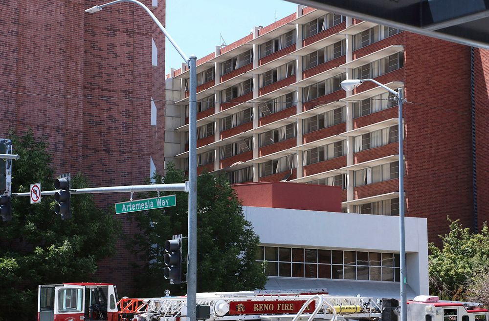 Rescue personnel respond to an explosion that damaged Argenta Hall and Nye Hall on the University of Nevada, Reno campus on Friday, July 5, 2019, in Reno, Nev. A Reno city spokesman says minor injuries have been reported after a utilities accident caused an explosion and