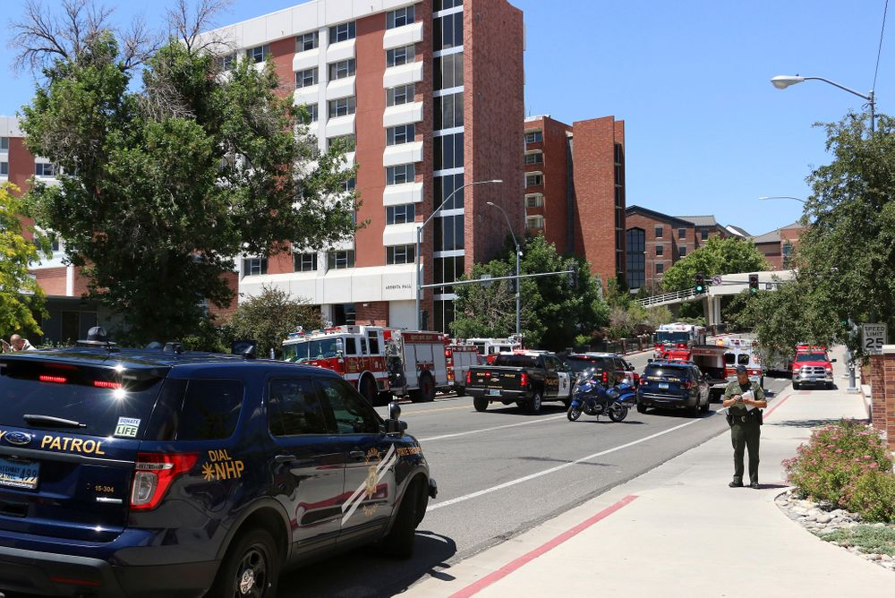 Rescue personnel respond to an explosion that damaged Argenta and Nye Halls on the University of Nevada, Reno, campus on Friday, July 5, 2019, in Reno, Nev. A Reno city spokesman says minor injuries have been reported after a utilities accident caused an explosion and