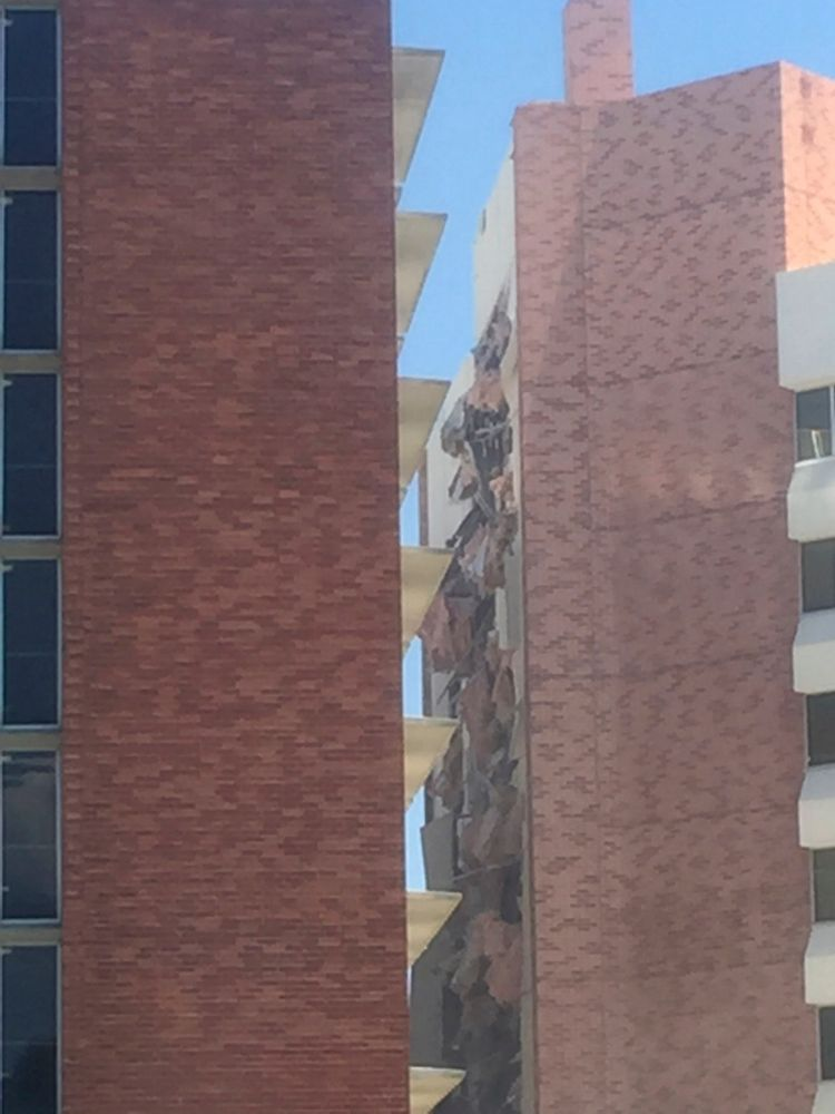 The aftermath of an explosion inside a residence hall at the University of Nevada, Reno in Reno, Nev., is visible on Friday, July 5, 2019. Police referred to the incident as a