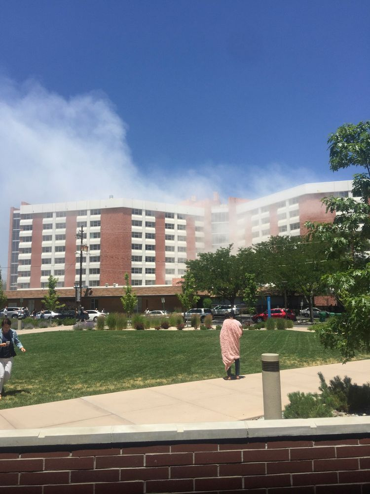 Plumes of smoke from an explosion inside a residence hall at the University of Nevada, Reno in Reno, Nev., is visible on Friday, July 5, 2019. Police referred to the incident as a