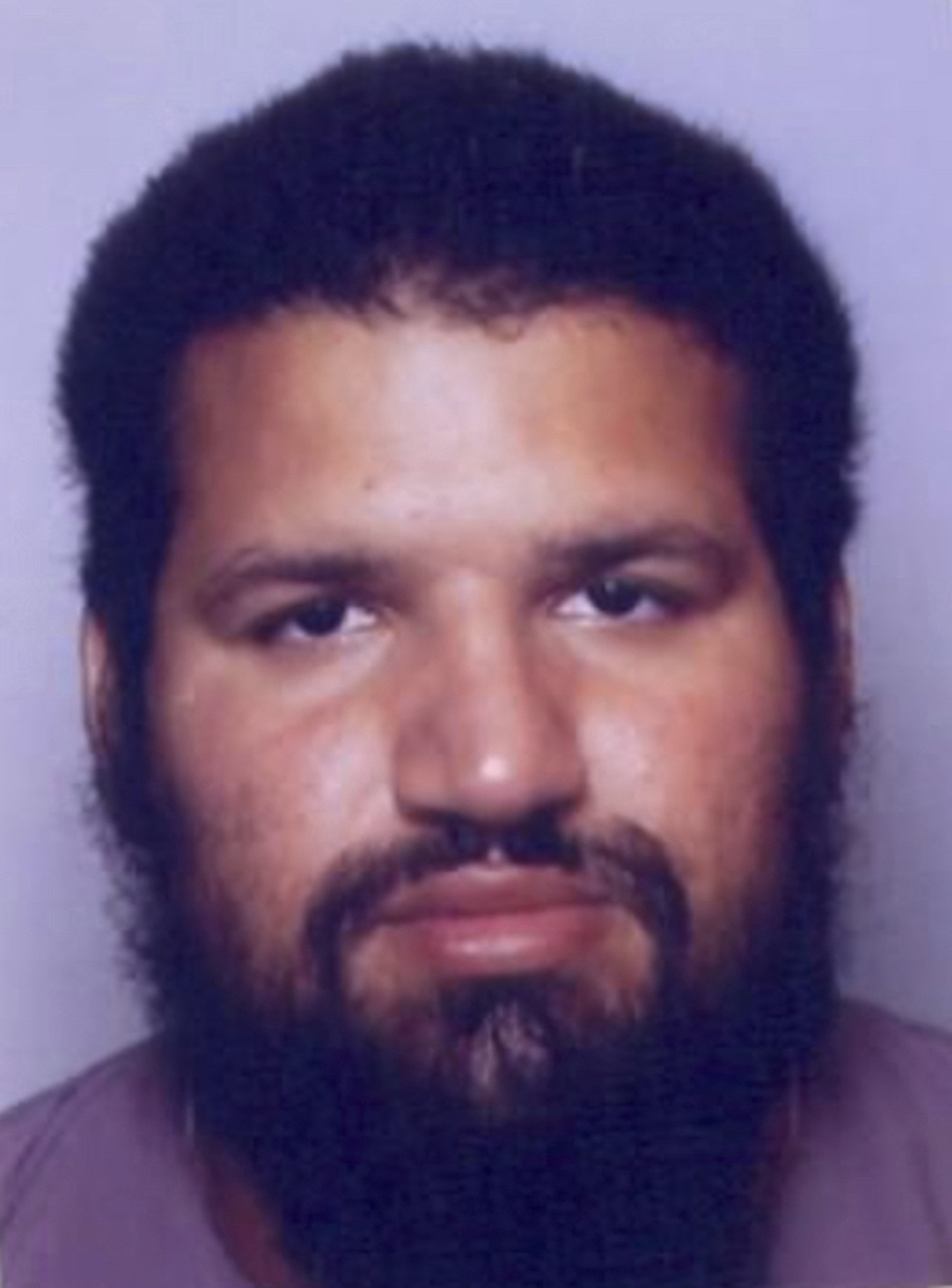 FILE - In this Thursday, Sept. 22, 2016, file picture, a screen grab from the Interpol wanted persons web page shows a portrait for Fabien Clain. French jihadist Fabien Clain known as the