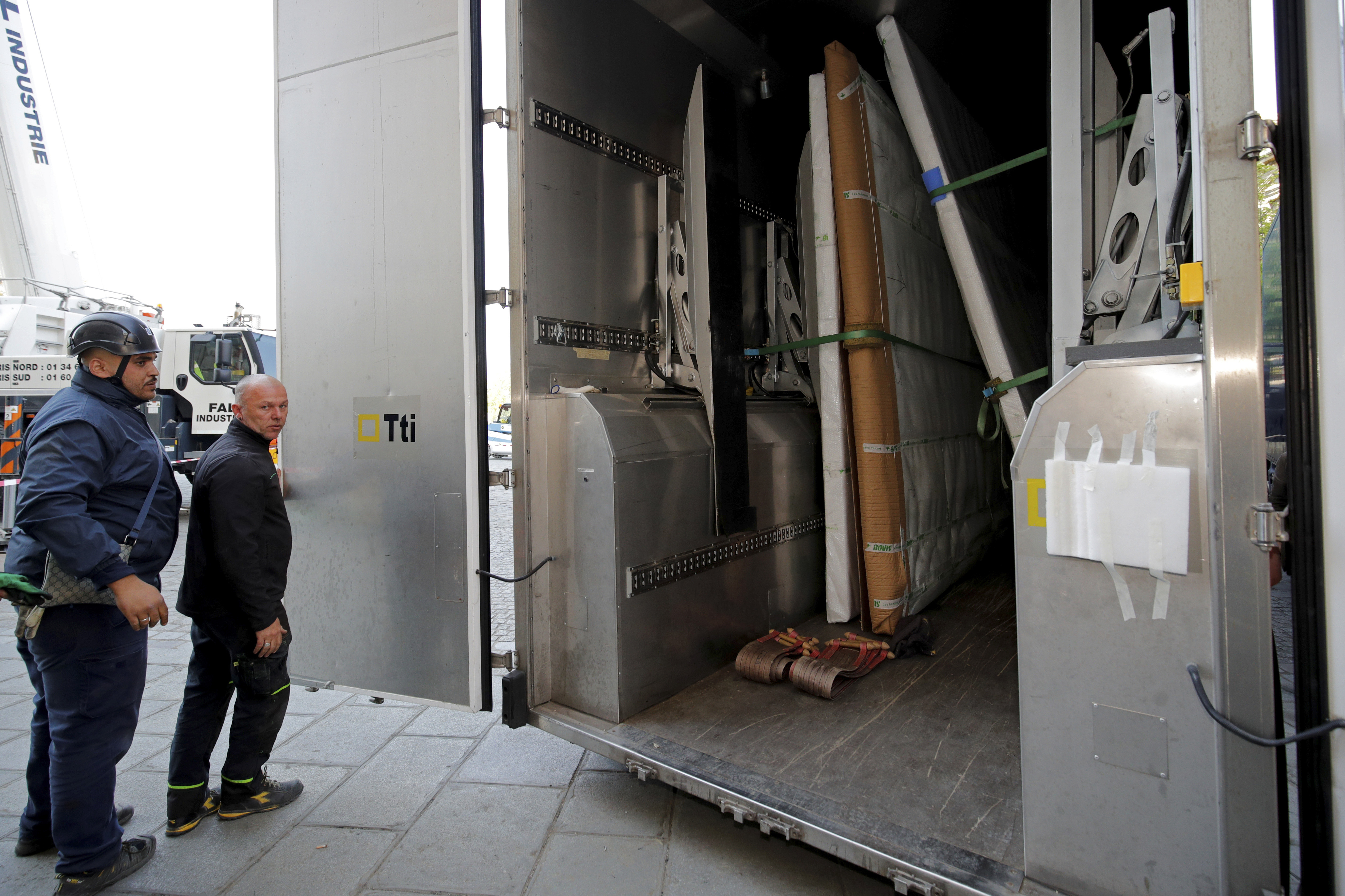Large artworks are seen in a truck after being removed from Notre-Dame Cathedral to be secured after a massive fire devastated large parts of the gothic cathedral in Paris, Friday, April 19, 2019. Rebuilding Notre Dame, the 800-year-old Paris cathedral devastated by fire this week, will cost billions of dollars as architects, historians and artisans work to preserve the medieval landmark. (Philippe Wojazer/Pool via AP)