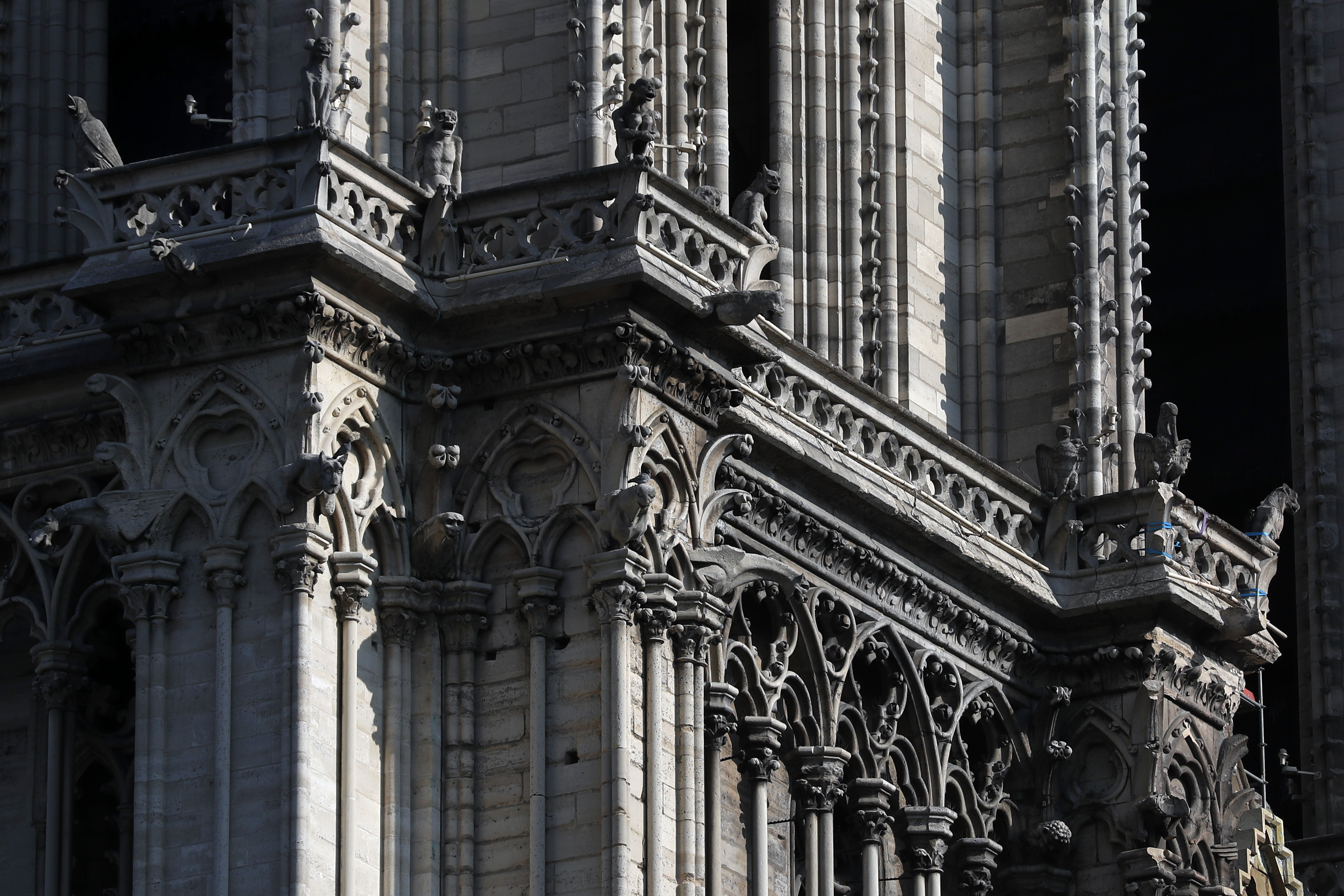 Gargoyles of Notre Dame cathedral are pictured Friday, April 19, 2019 in Paris. Rebuilding Notre Dame, the 800-year-old Paris cathedral devastated by fire this week, will cost billions of dollars as architects, historians and artisans work to preserve the medieval landmark. (AP Photo/Thibault Camus)