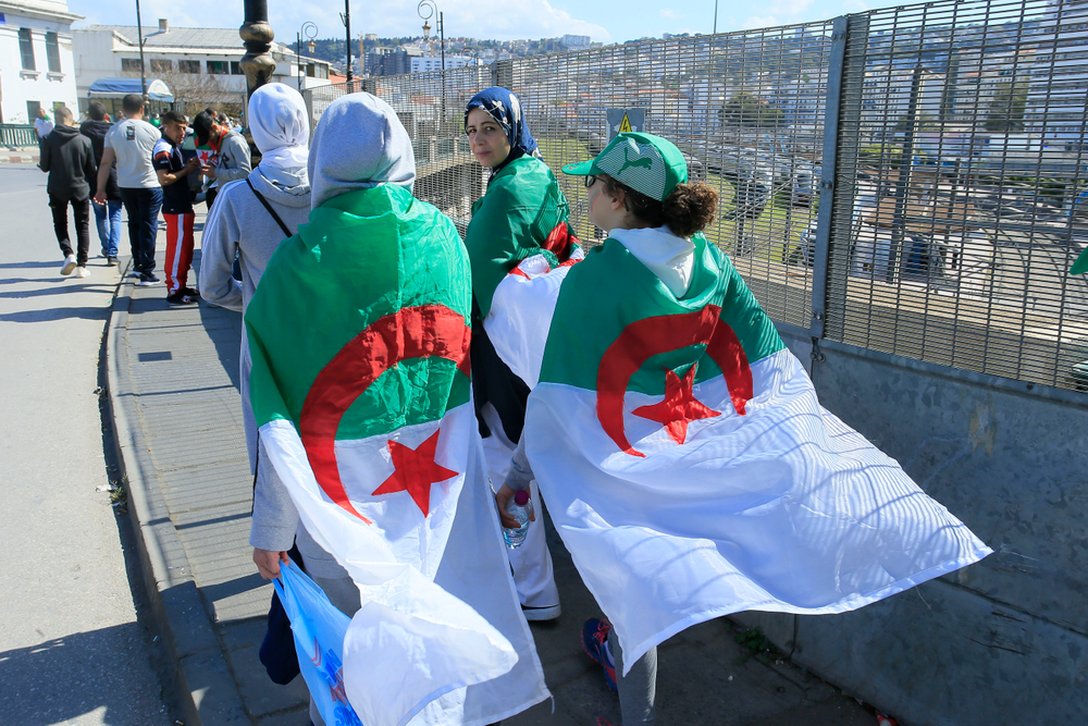 Women wear the Algerian flag during a protest in Algiers, Friday, April 26, 2019. Algerians are massing for a 10th week of protests against their country's ruling class, calling for the ex-president's brother to be put on trial. (AP Photo/Anis Belghoul)