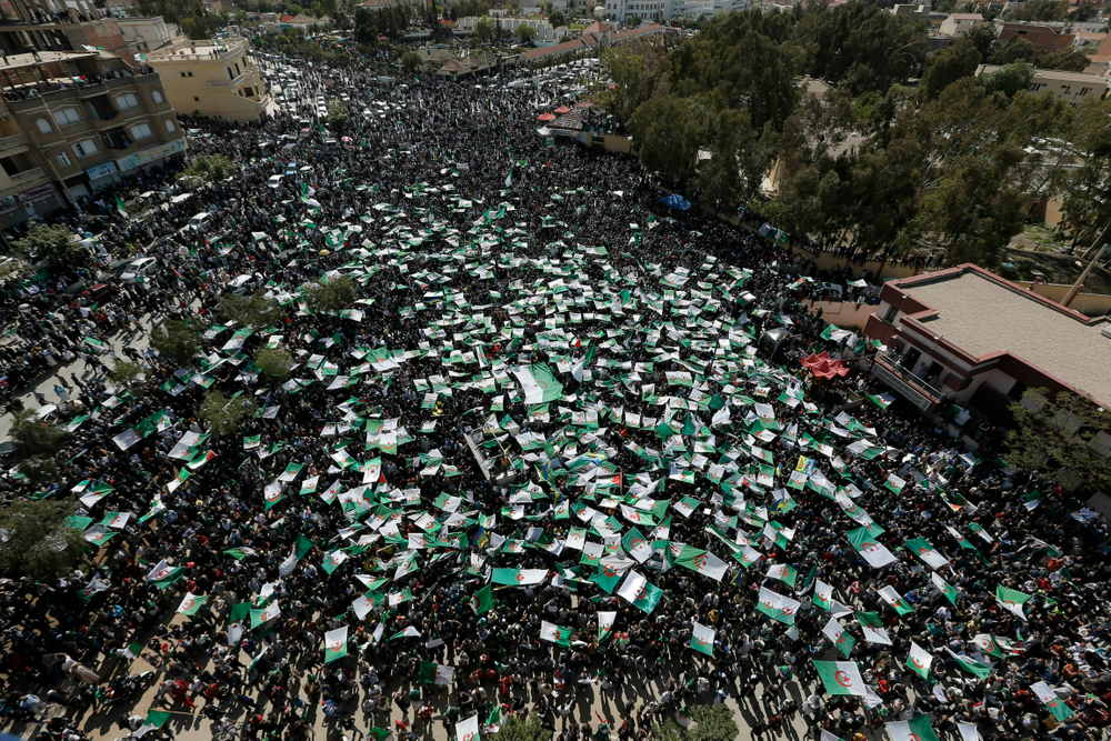 Demonstrators hold Algerian flags during a protest in Bordj Bou Arreridj, east of Algiers, Friday, April 26, 2019. Algerians are massing for a 10th week of protests against their country's ruling class, calling for the ex-president's brother to be put on trial. (AP Photo/Toufik Doudou)
