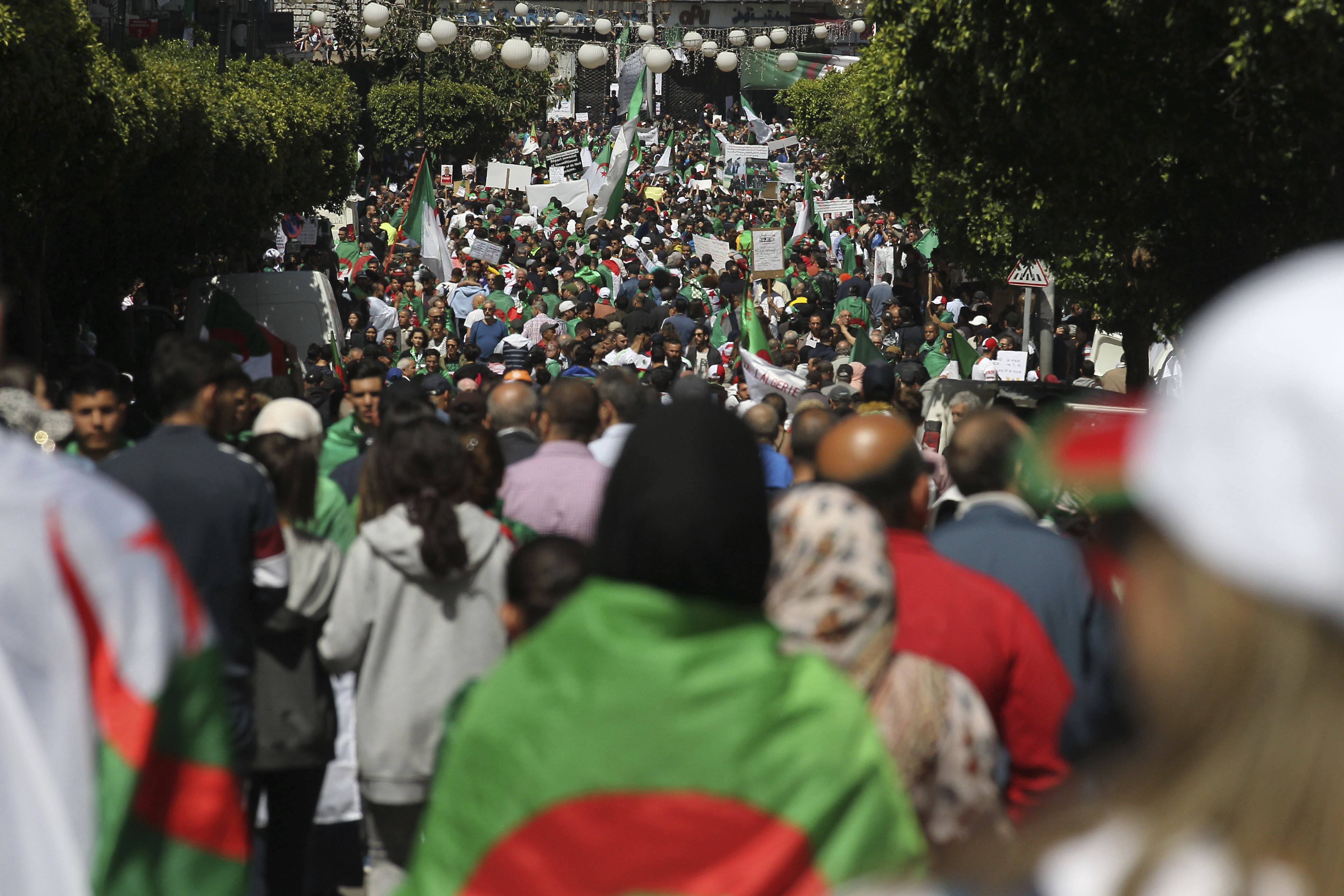 Demonstrators march during a protest in Algiers, Friday, April 26, 2019. Algerians are massing for a 10th week of protests against their country's ruling class, calling for the ex-president's brother to be put on trial. (AP Photo/Fateh Guidoum)
