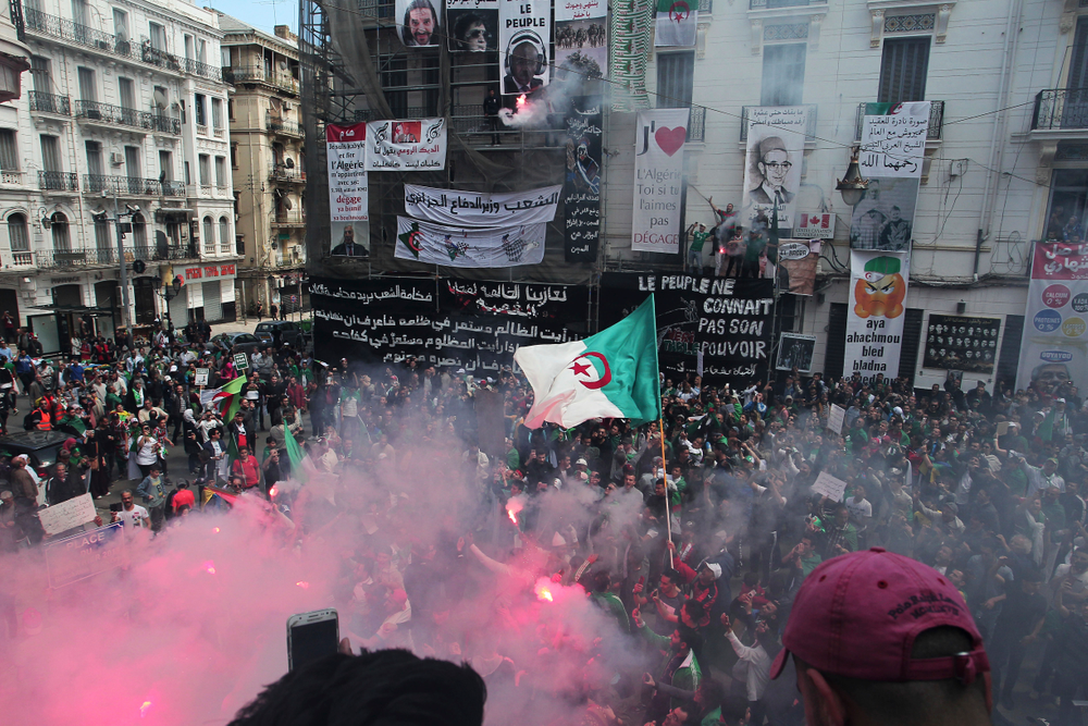 Demonstrators hold flares during a protest in Algiers, Friday, April 26, 2019. Algerians are massing for a 10th week of protests against their country's ruling class, calling for the ex-president's brother to be put on trial. (AP Photo/Fateh Guidoum)
