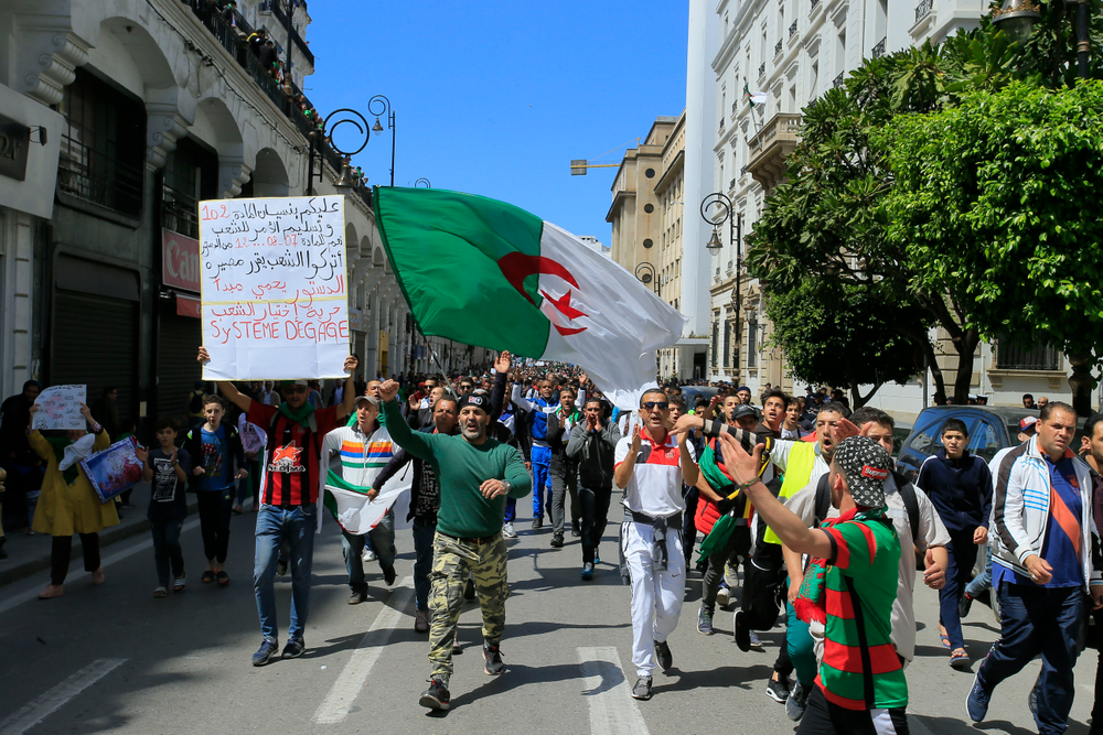 Demonstrators chant slogans during a protest in Algiers, Friday, April 26, 2019. Algerians are massing for a 10th week of protests against their country's ruling class, calling for the ex-president's brother to be put on trial. (AP Photo/Anis Belghoul)