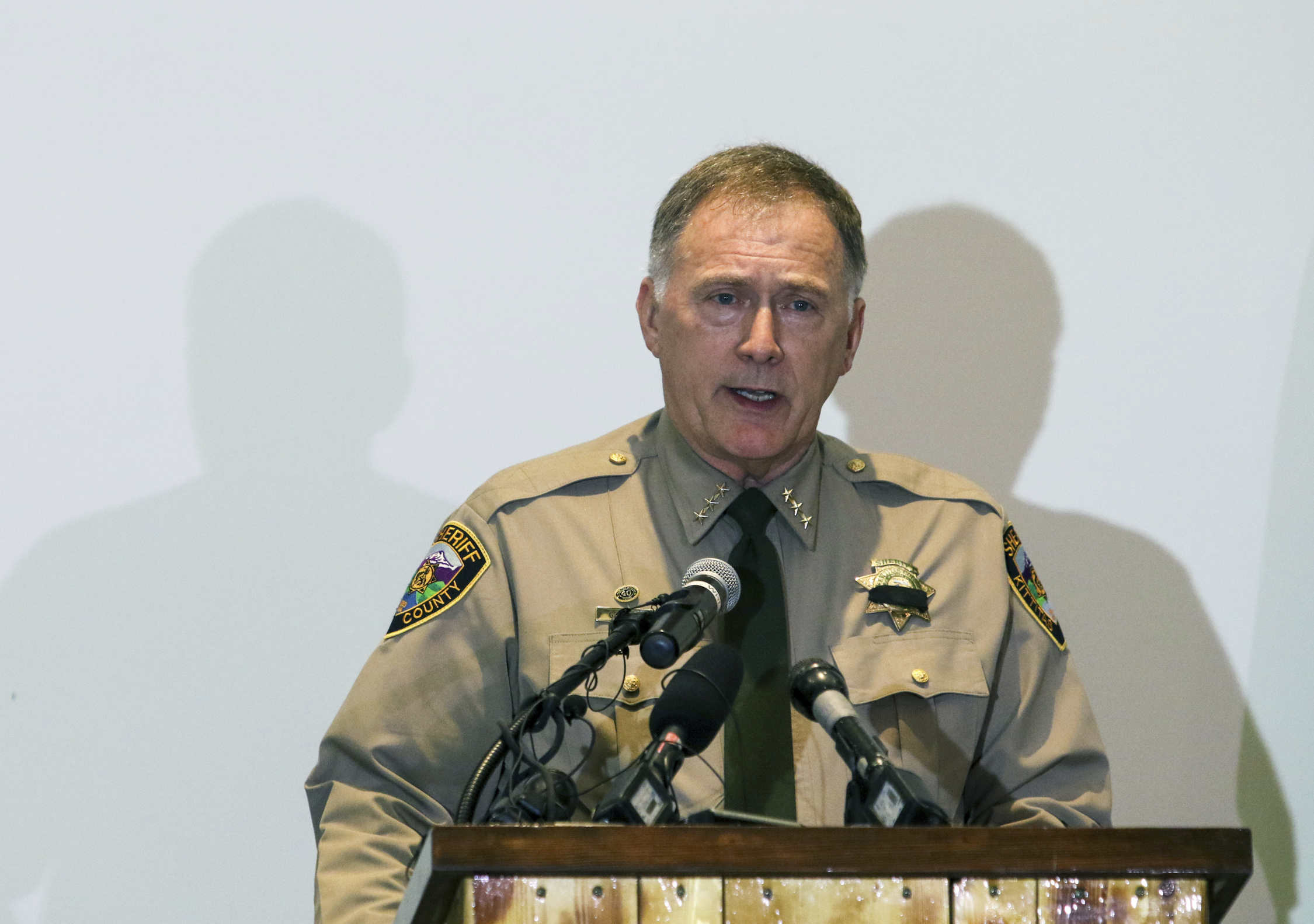 Kittitas County Sheriff Gene Dana speaks at a news conference, Wednesday, March 20, 2019, in Ellensburg, Wash. about the death of Deputy Ryan Thompson, who was killed Tuesday evening when he and a Kittitas Police officer exchanged gunfire with a road-rage driving suspect in Kittitas, Wash. The driver of the vehicle was also shot and later died at a hospital. (Jake Green/The Daily Record via AP)