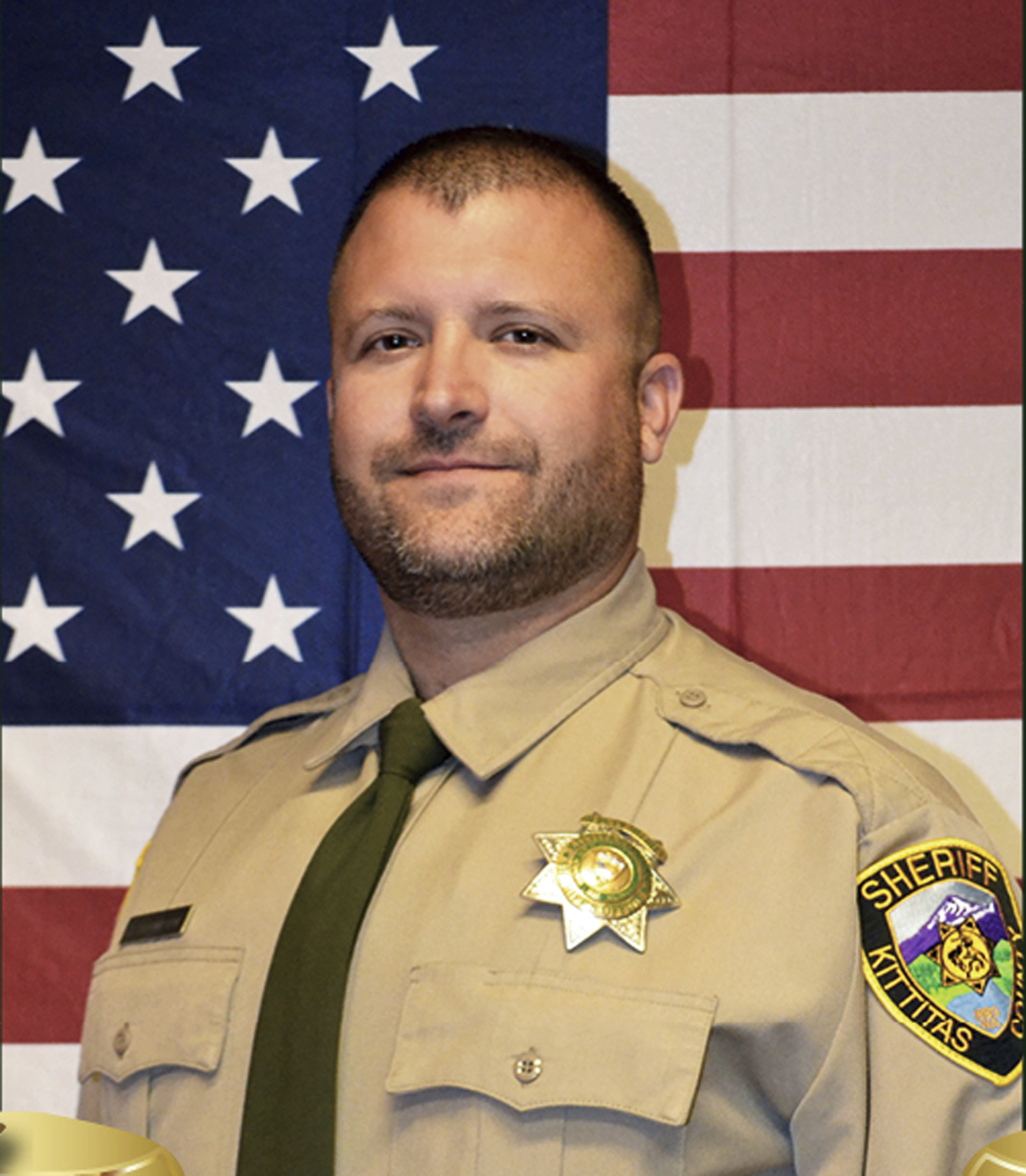 This undated photo released by the Kittitas County Sheriff's Office shows Deputy Ryan Thompson. Thompson, 42, was shot and killed and a police officer was wounded after they exchanged gunfire with a road rage driving suspect Tuesday, March 19, 2019, authorities said Wednesday, March, 20, 2019. The events unfolded Tuesday evening when the two officers tried to stop the suspect's vehicle after authorities received a complaint about the motorist's driving, authorities said. (Kittitas County Sheriff's Office via AP)