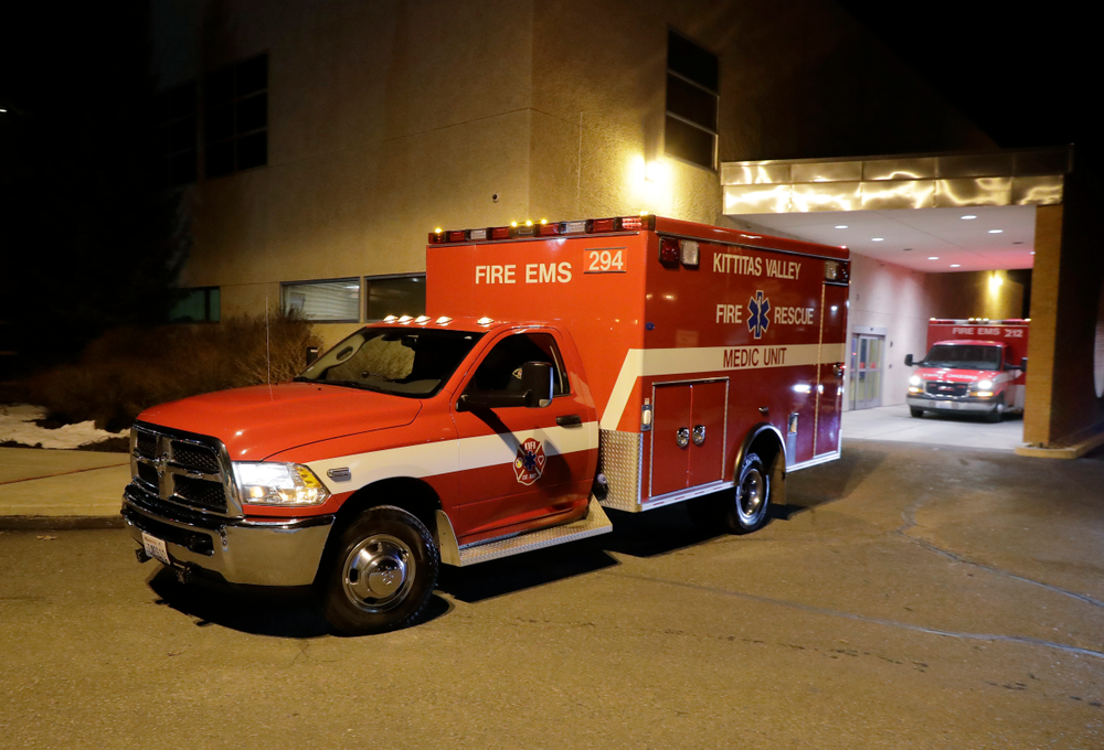 A Kittitas Valley Fire & Rescue ambulance carries the body of a Kittitas County Sheriff's deputy away from Kittitas Valley Healthcare Hospital, in the early morning hours of Wednesday, March 20, 2019, in Ellensburg, Wash. A Kittitas County Sheriff's deputy was killed and a police officer was injured after an exchange of gunfire during an attempted traffic stop. (AP Photo/Ted S. Warren)