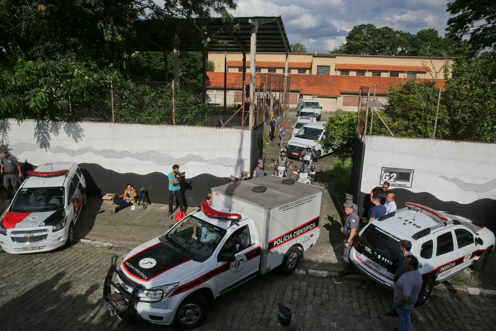 Forensic vehicles transport the bodies of the people who were killed in a school shooting at the Raul Brasil State School in Suzano, in the greater Sao Paulo area, Brazil, Wednesday, March 13, 2019. Two masked former students armed with guns, knives, axes and crossbows descended on the school Wednesday, killing five students and two adults before taking their own lives, authorities said. (AP Photo/Andre Penner)