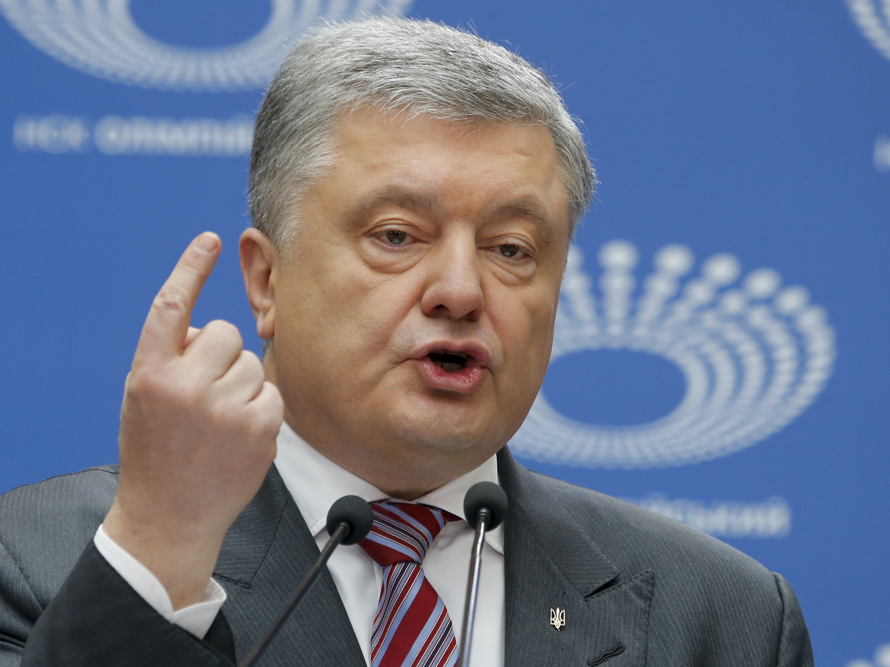 Ukrainian President Petro Poroshenko gestures as he answers to a journalist's question ahead of the presidential elections on April 21, at the Olympic stadium in Kiev, Ukraine, Sunday, April 14, 2019. With one week remaining until Ukraine's presidential election, incumbent Petro Poroshenko has come to the country's largest stadium for a proposed debate where his opponent didn't show up. (AP Photo/Efrem Lukatsky)