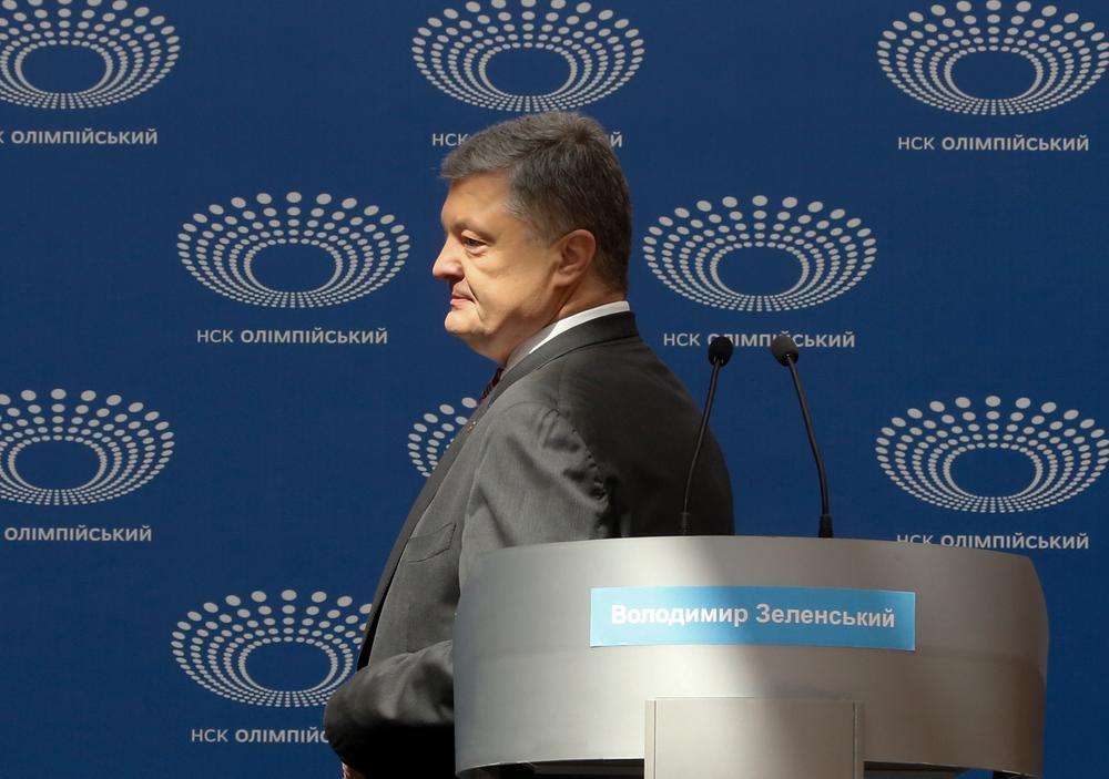 Ukrainian President Petro Poroshenko arrives to deliver his speech ahead of the presidential elections on April 21, at the Olympic stadium in Kiev, Ukraine, Sunday, April 14, 2019. (AP Photo/Efrem Lukatsky)