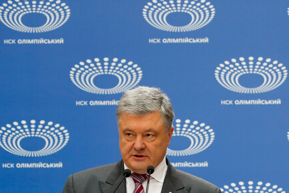 Ukrainian President Petro Poroshenko answers to a journalist's question ahead of the presidential elections on April 21, at the Olympic stadium in Kiev, Ukraine, Sunday, April 14, 2019. (AP Photo/Efrem Lukatsky)
