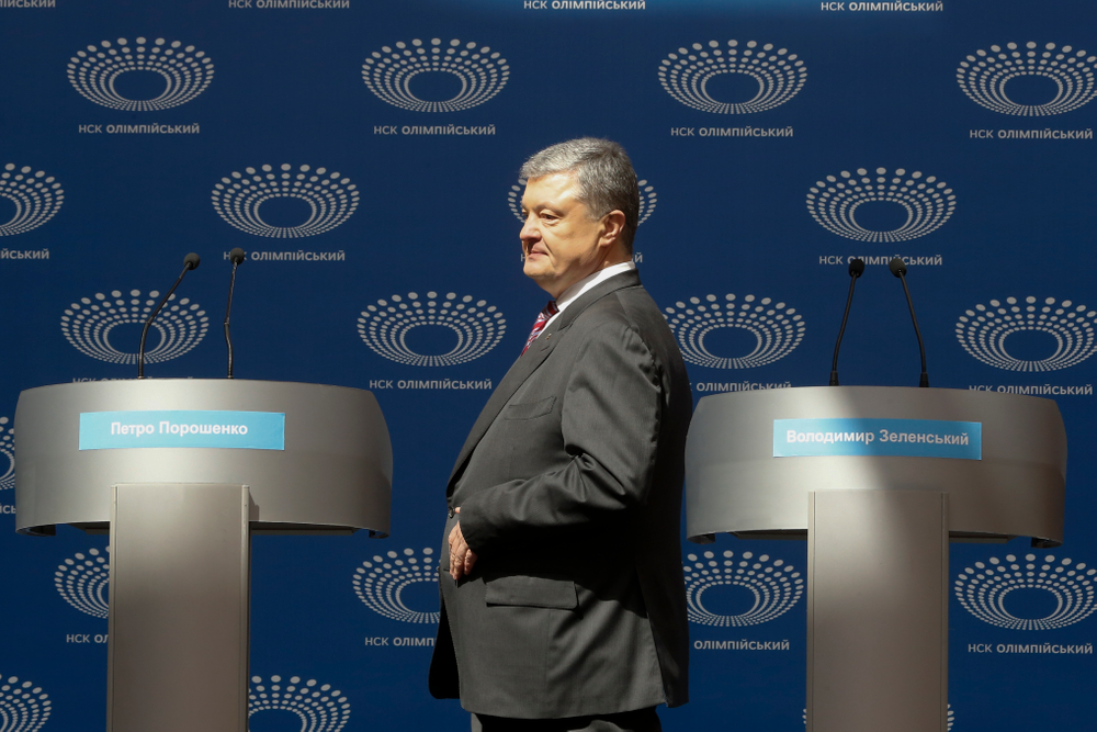 Ukrainian President Petro Poroshenko arrives to deliver his speech ahead of the presidential elections on April 21, at the Olympic stadium in Kiev, Ukraine, Sunday, April 14, 2019. With one week remaining until Ukraine's presidential election, incumbent Petro Poroshenko has come to the country's largest stadium for a proposed debate where his opponent didn't show up. (AP Photo/Efrem Lukatsky)