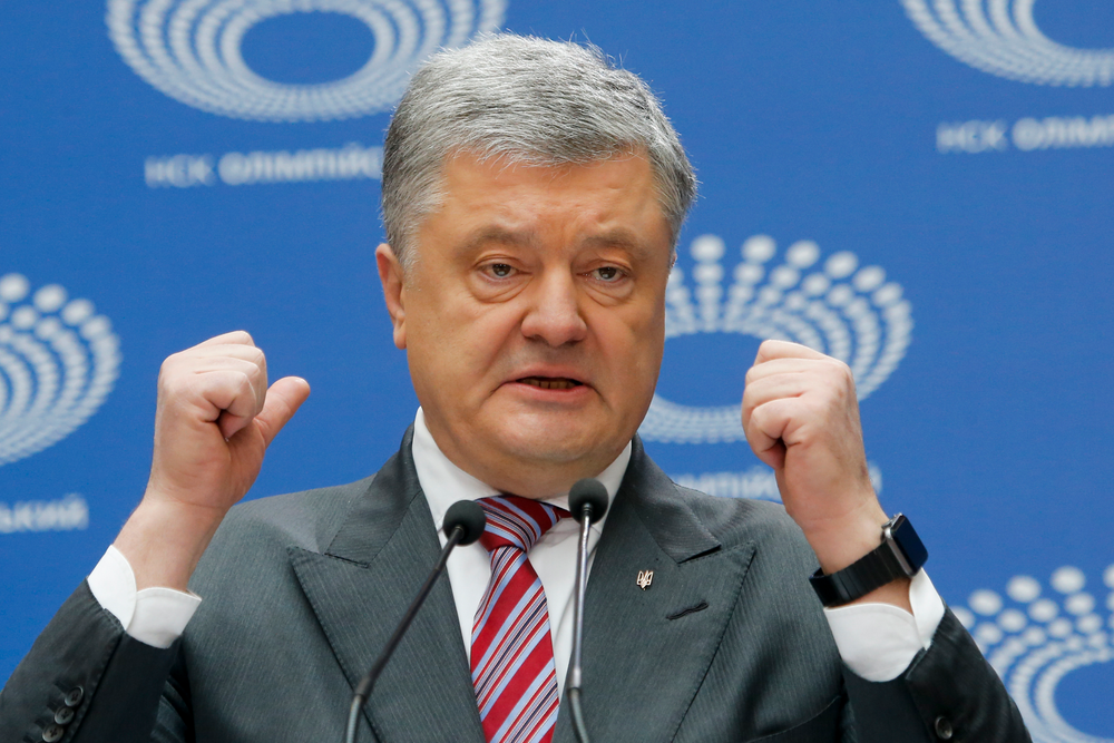 Ukrainian President Petro Poroshenko gestures while answering to a journalist's question ahead of the presidential elections on April 21, at the Olympic stadium in Kiev, Ukraine, Sunday, April 14, 2019. (AP Photo/Efrem Lukatsky)