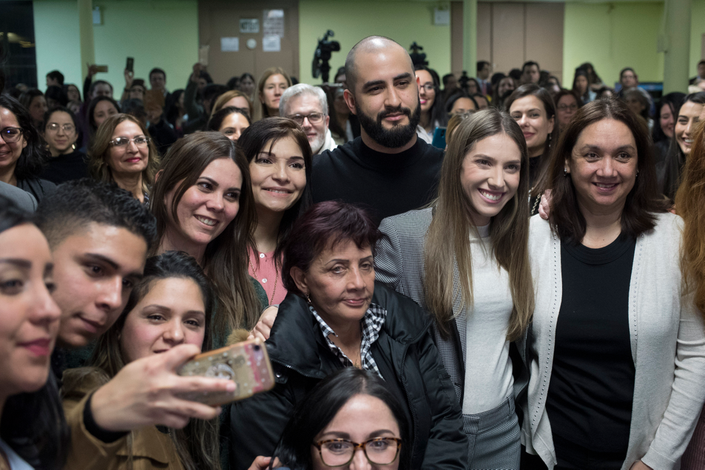 Fabiana Rosales, second from right, wife of Venezuelan opposition leader Juan Guaido, and Aminta Perez, third from right, mother of Venezuelan police Officer Oscar Perez, pose for a photo with members of the Venezuelan community in New York after attending Mass at St. Teresa's Church on the Lower East Side of Manhattan, Tuesday, March 26, 2019. Rosales is emerging as a prominent figure in Guaido's campaign to bring change in the crisis-wracked country. (AP Photo/Mary Altaffer)