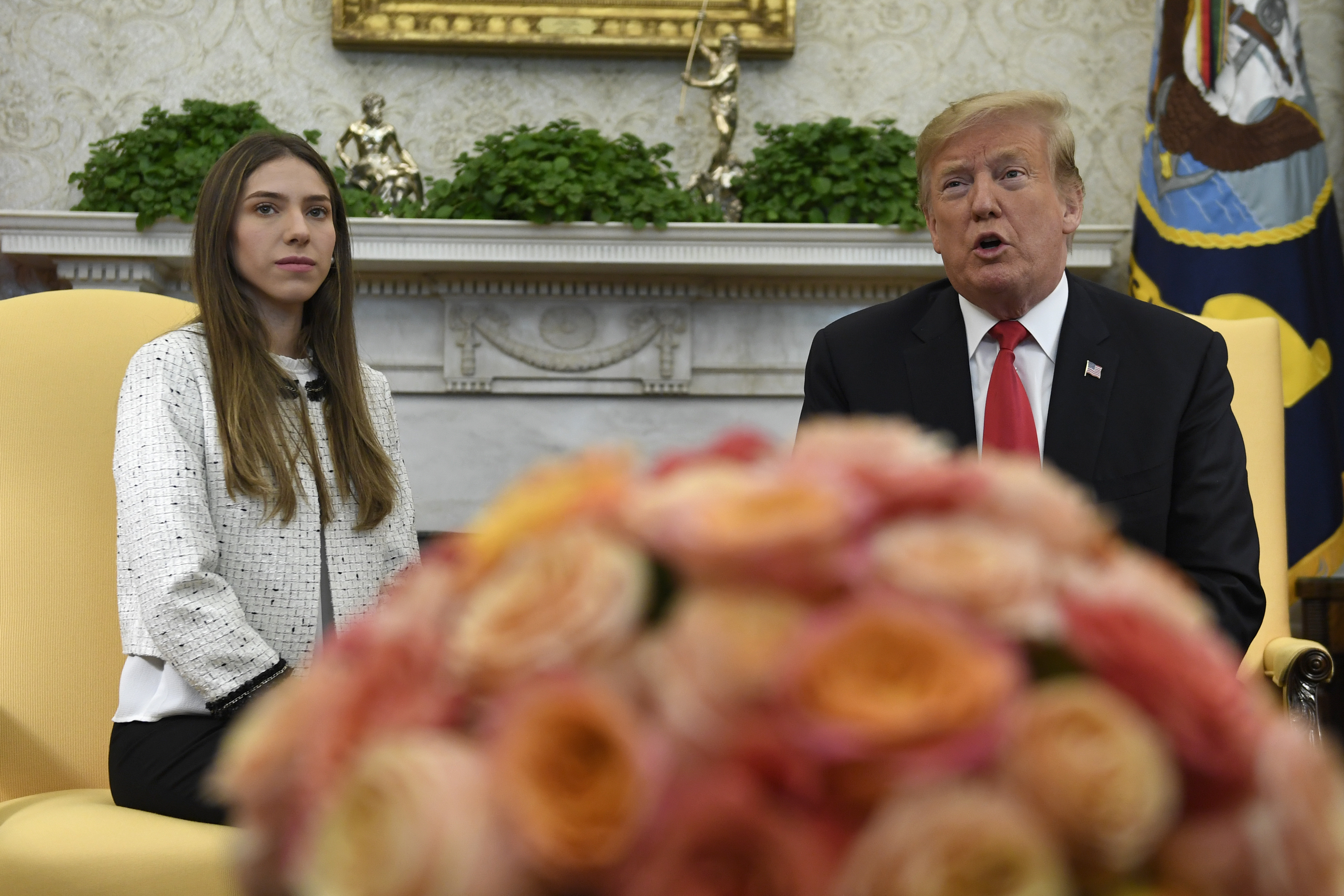 President Donald Trump, right, speaks during a meeting with Fabiana Rosales, left, a Venezuelan activist who is the wife of Venezuelan opposition leader Juan Guaido, in the Oval Office of the White House in Washington, Wednesday, March 27, 2019. (AP Photo/Susan Walsh)