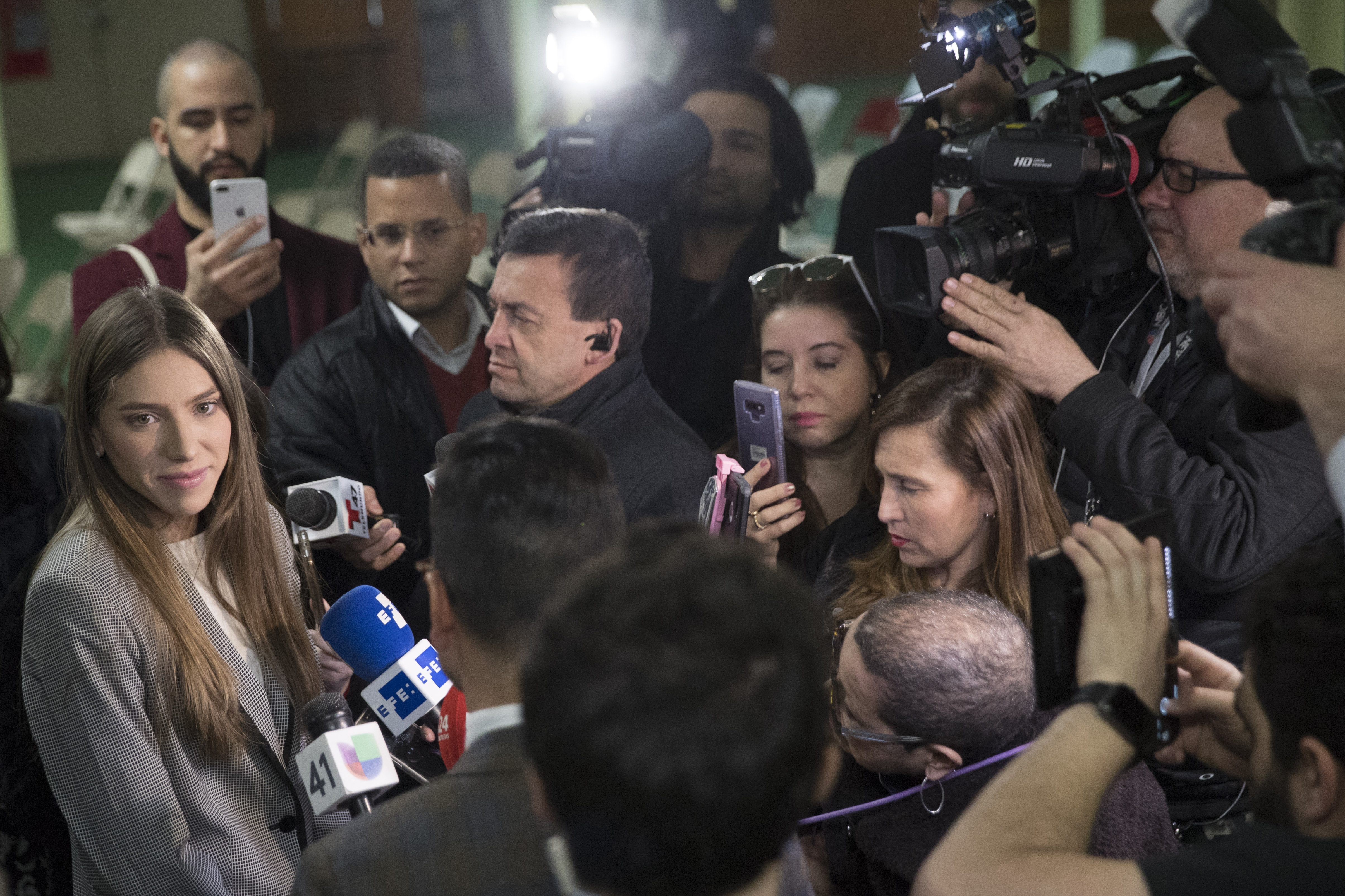 Fabiana Rosales, left, wife of Venezuelan opposition leader Juan Guaido, speaks to reporters before attending Mass at St. Teresa's Church on the Lower East Side of Manhattan, Tuesday, March 26, 2019, in New York. Rosales is emerging as a prominent figure in Guaido's campaign to bring change in the crisis-wracked country. (AP Photo/Mary Altaffer)