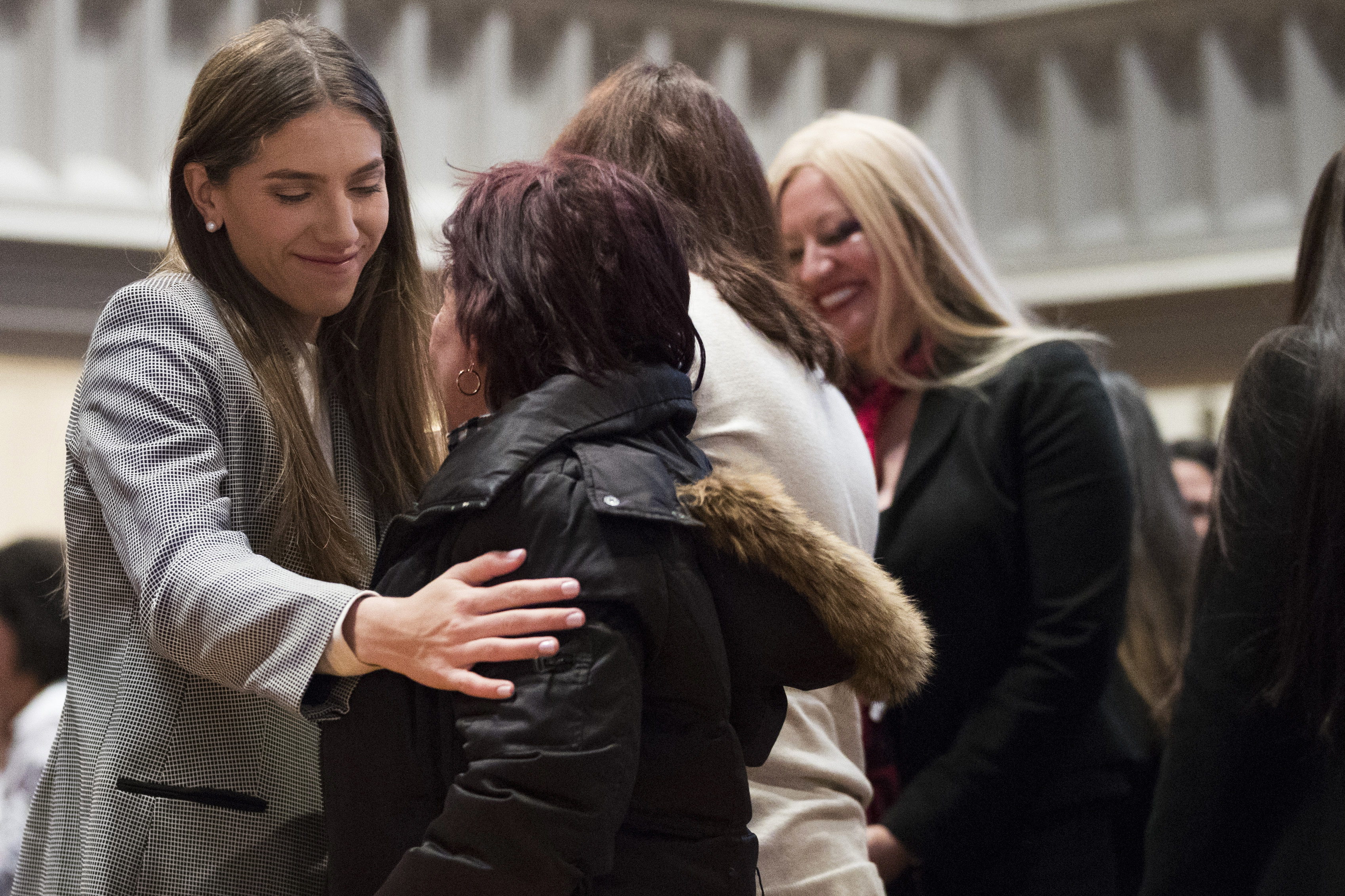 Fabiana Rosales, left, wife of Venezuelan opposition leader Juan Guaido, hugs Aminta Perez, mother of Venezuelan police Officer Oscar Perez, while celebrating Mass at St. Teresa's Church on the Lower East Side of Manhattan, Tuesday, March 26, 2019, in New York. Rosales is emerging as a prominent figure in Guaido's campaign to bring change in the crisis-wracked country. (AP Photo/Mary Altaffer)