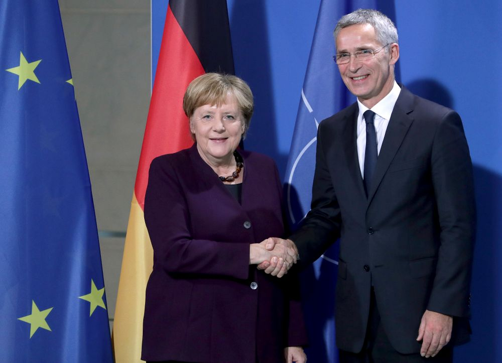 German Chancellor Angela Merkel, left, and NATO Secretary General Jens Stoltenberg, right, shake hands after a joint a press conference at the Chancellery in Berlin, Germany, Thursday, Nov. 7, 2019. (AP Photo/Michael Sohn)