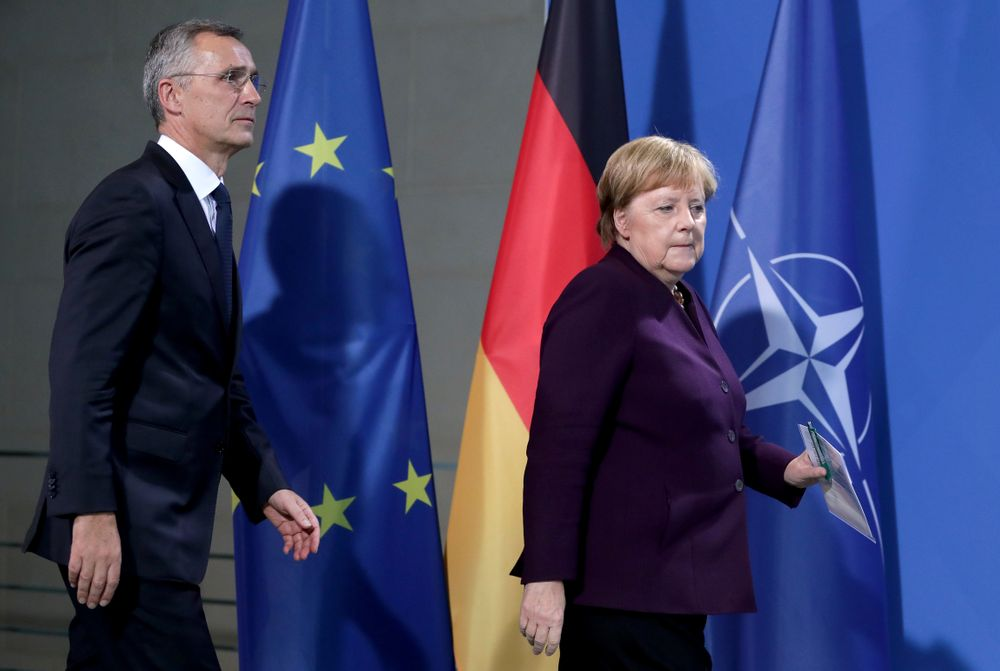 German Chancellor Angela Merkel, right, and NATO Secretary General Jens Stoltenberg, left, arrive for a press conference after a meeting at the Chancellery in Berlin, Germany, Thursday, Nov. 7, 2019. (AP Photo/Michael Sohn)