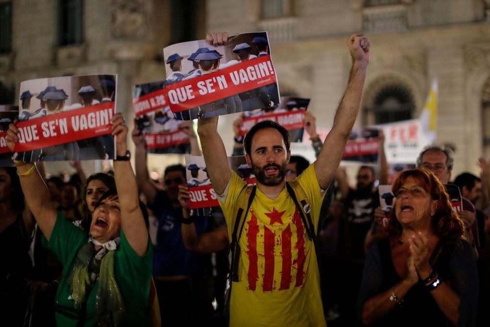 CORRECTS PHOTOGRAPHER NAME - People protest against the detention of seven Catalan independence supporters during a demonstration in Sant Jaume square, Barcelona, Spain, Thursday, Sept. 26, 2019. Spain's National Court says a judge is sending to jail seven Catalan independence supporters who were arrested this week for allegedly planning violent acts, possibly with explosives. A court statement says an investigating judge has found signs that the seven could be part of an organization that intends to use