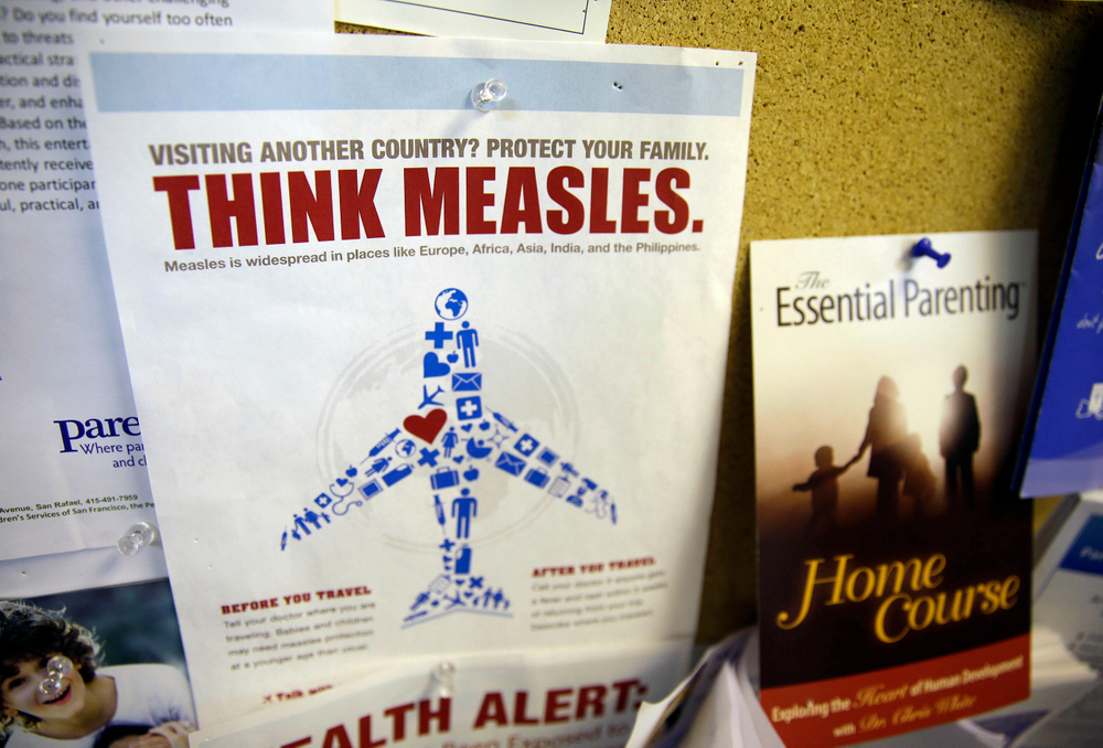 FILE - In this Feb. 6, 2015, file photo, a flyer educating parents about measles is displayed on a bulletin board at a pediatrics clinic in Greenbrae, Calif. State health officials say the number of measles cases is up in California in 2019 and much of the increase is linked to overseas travel. Dr. Karen Smith, director of the California Department of Public Health, says the state recorded 38 measles cases as of Thursday, April 25, 2019, versus 11 around the same time last year. She says the state typically sees fewer than two dozen cases a year. (AP Photo/Eric Risberg, File)