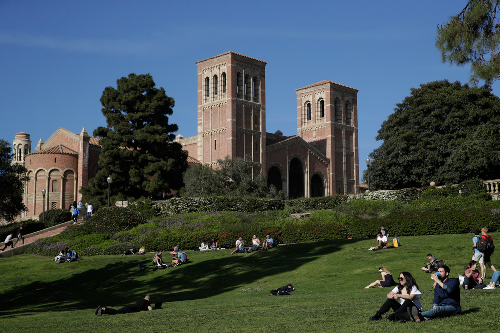 Students sit on the lawn near Royce Hall at UCLA Thursday, April 25, 2019, in the Westwood section of Los Angeles. Hundreds of students and staff at two Los Angeles universities, including UCLA, have been placed under quarantine because they may have been exposed to measles. Officials say the people affected by the order either have not been vaccinated or cannot verify that they are immune. (AP Photo/Jae C. Hong)