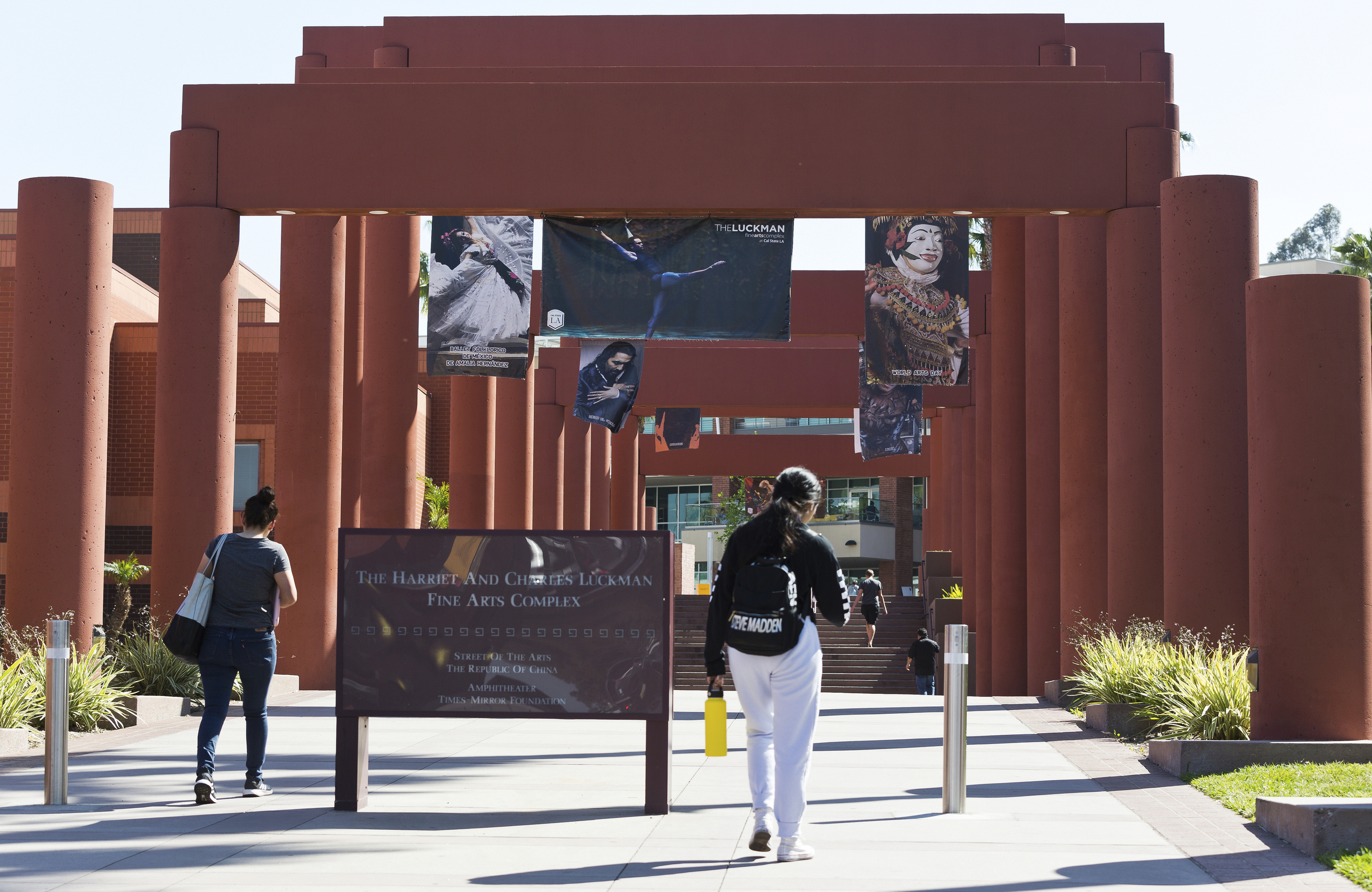 Students walk past the Harriet and Charles Luckman Fine Arts Complex at the The Cal State University, Los Angeles campus Thursday, April 25, 2019. Hundreds of students and staff at two Los Angeles universities, including Cal State University, have been placed under quarantine because they may have been exposed to measles and either have not been vaccinated or cannot verify that they are immune, officials said Thursday. (AP Photo/Damian Dovarganes)