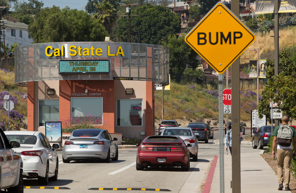 Students drive to Cal State University, Los Angeles campus Thursday, April 25, 2019. Hundreds of students and staff at two Los Angeles universities, including Cal State University, have been placed under quarantine because they may have been exposed to measles. Officials say the people affected by the order either have not been vaccinated or cannot verify that they are immune. (AP Photo/Damian Dovarganes)